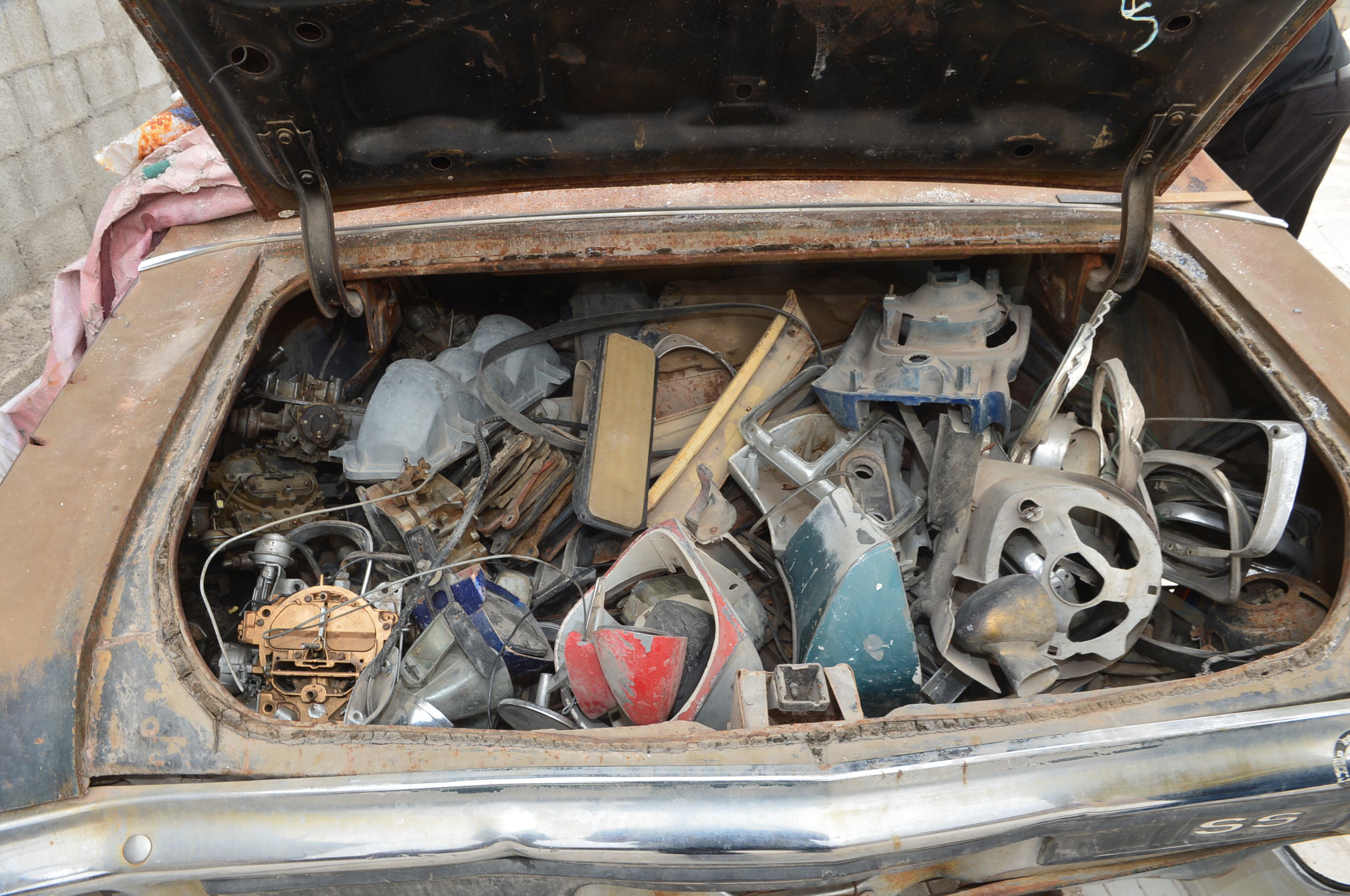 The trunk was also full of car parts.