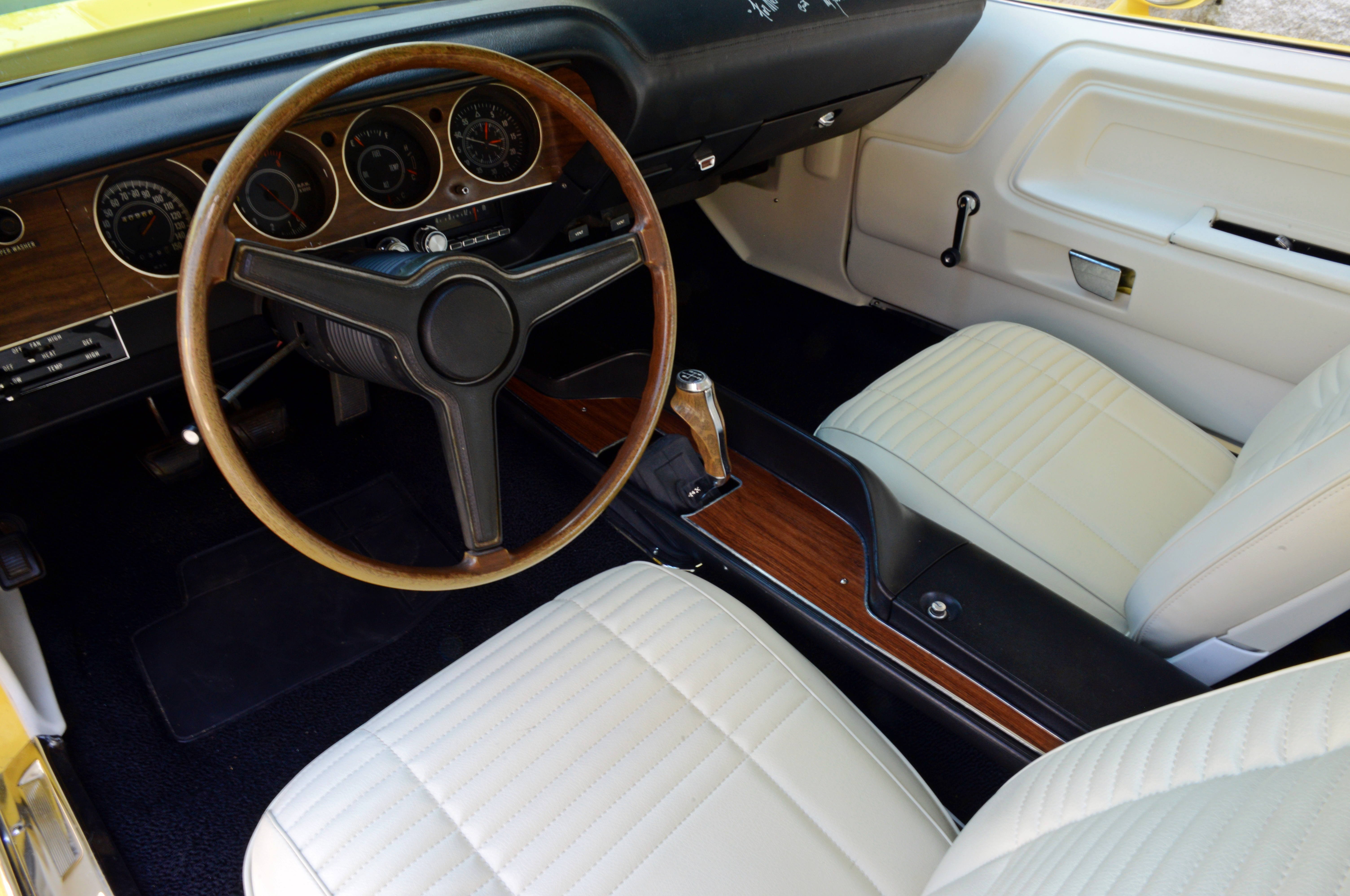 The white interior (and white vinyl top) nicely accent the Challenger's Top Banana yellow paint outside. Pistol Grip shifter rows a four-speed trans linked to the Dana axle.