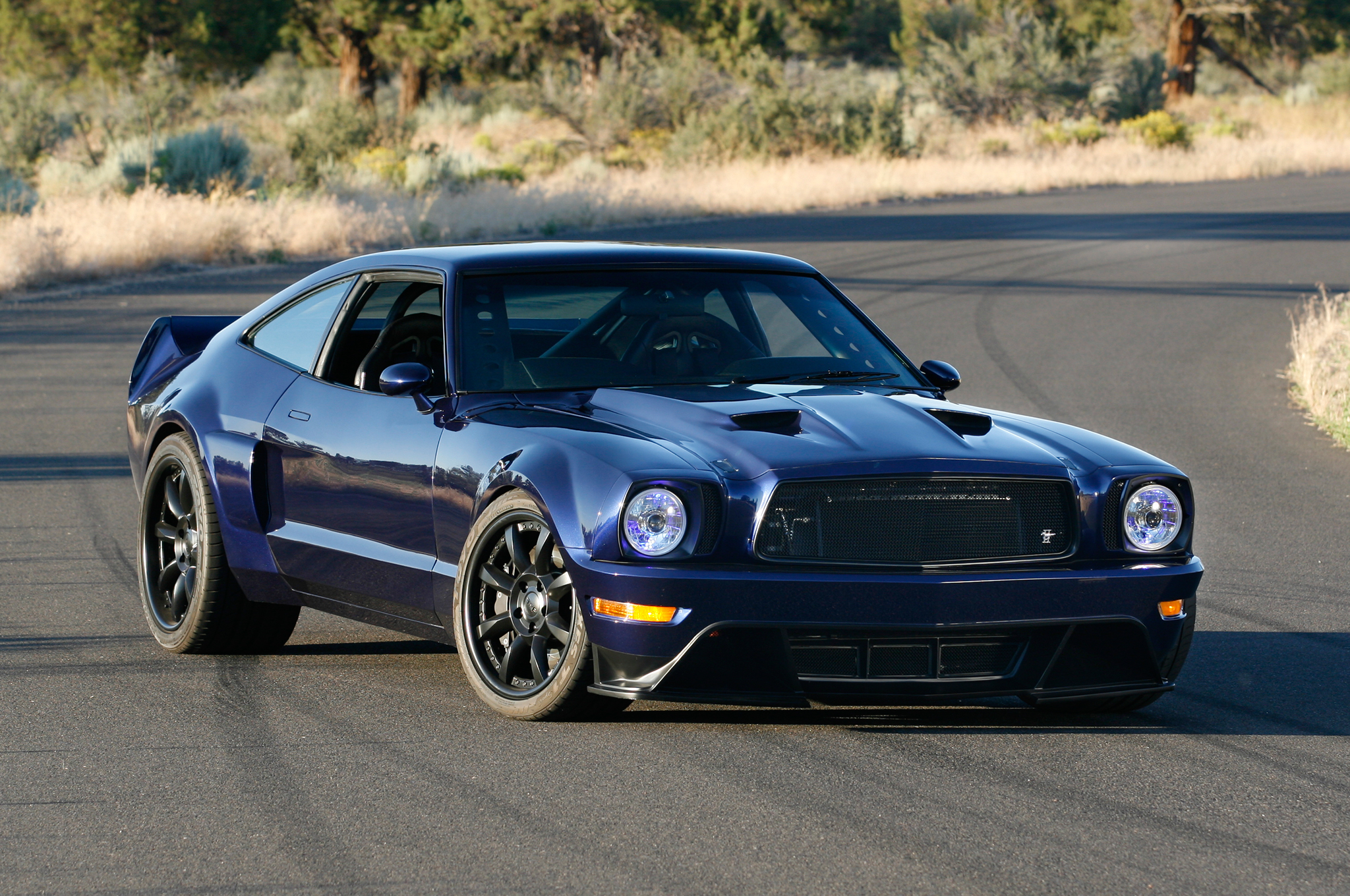 The Mustang Evolution draws design elements from a number of different eras. A good example is the hoodscoop assembly, which sharp eyes will identify as being 1971 Mustang sourced. Gordon Aram deftly cut off the metal skin of the 1971 hood, reshaped it, and grafted it to a Mustang II hood frame – of course that's a slight oversimplification of the complicated job!
