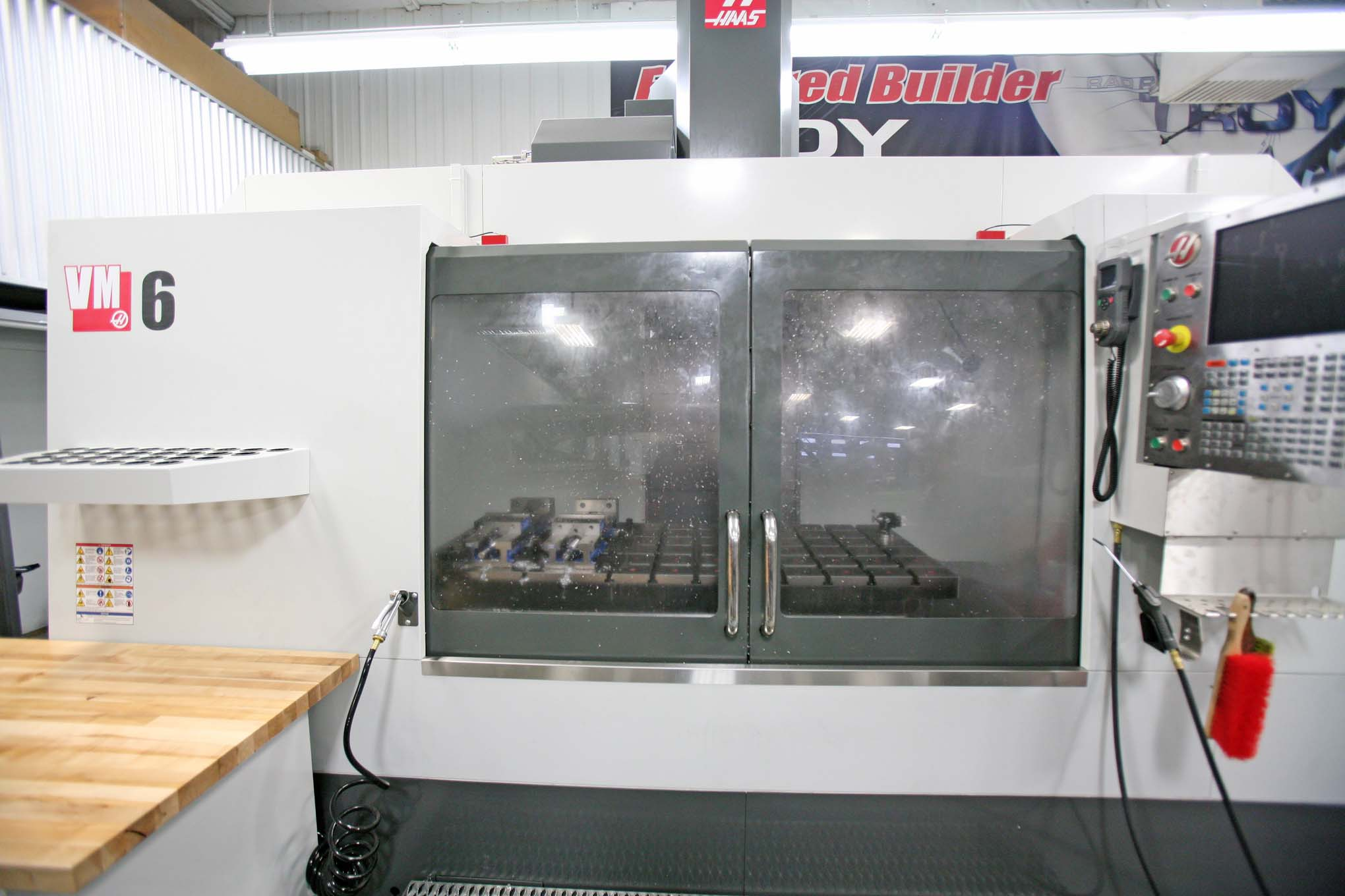 This is the shop's newest tool, a huge CNC machine capable of 64 and 32 inches of travel on the X and Y axes, respectively. That's more than enough travel to machine wheels, which was the first job of the new tool. They're destined for the Speed Demon Team streamliner currently being built in Ventura, California.