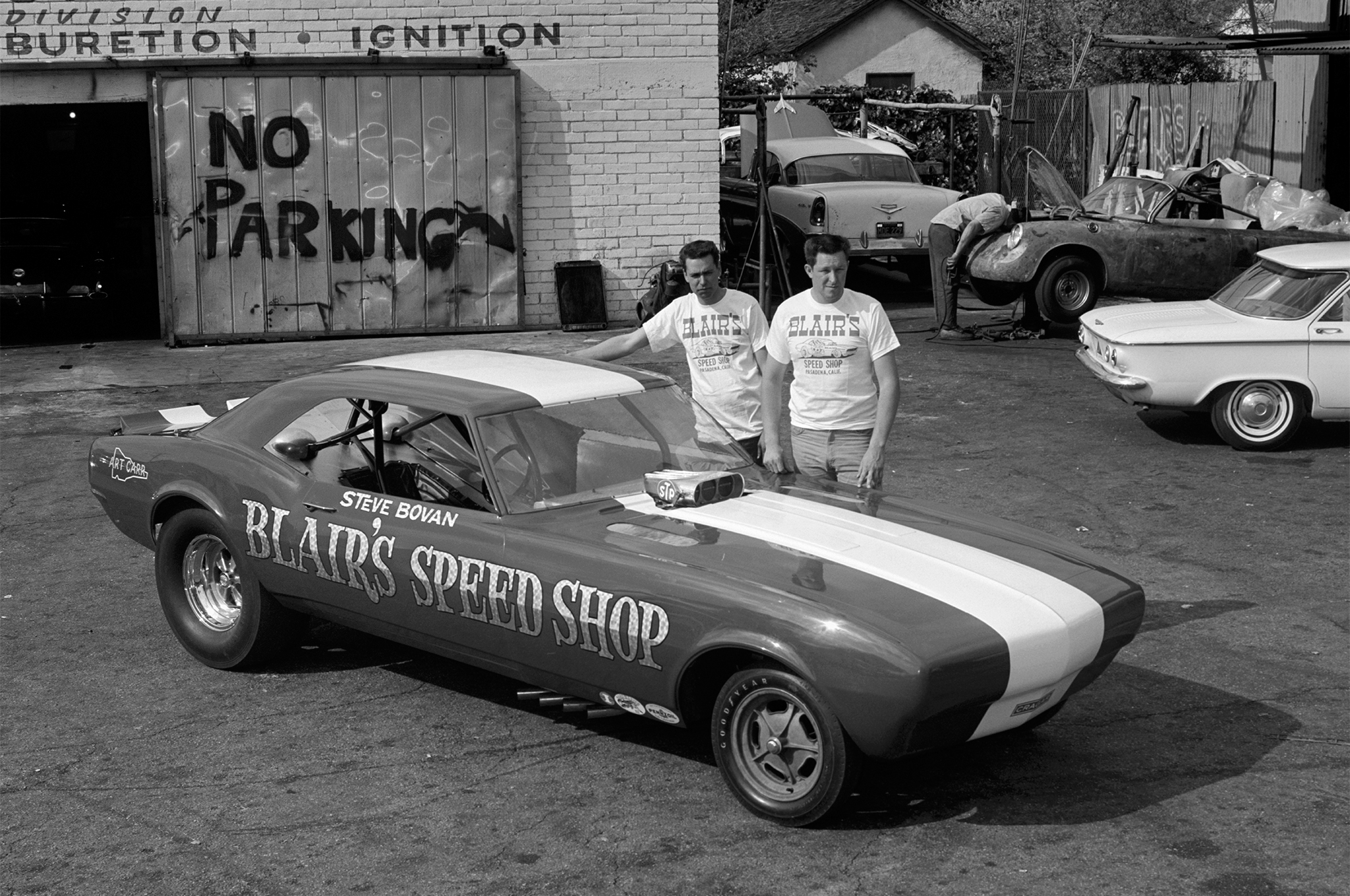 In 1967 Bovan stepped up to a Camaro Funny Car built at Blair's by Mike Hoag, seen with Bovan at Blair's. The chassis was similar in some ways to a dragster chassis, but incorporated torsion bars with the idea they could load the chassis, which was an influence from Don Blair's sprint-car racing experience.