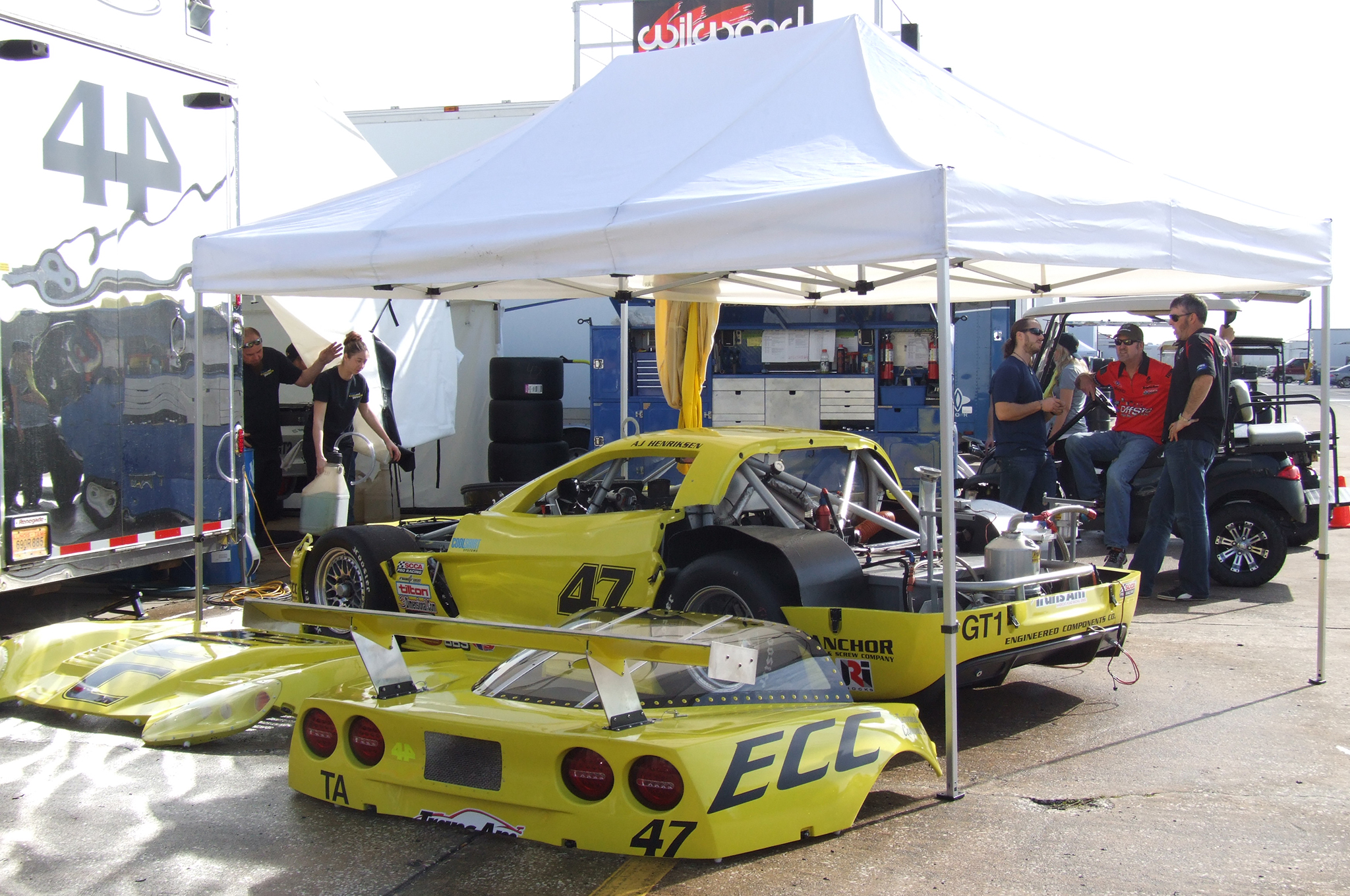There's a lot to see in the pits, from internal details of race cars to vendors, such as Heacock Classic Car Insurance.