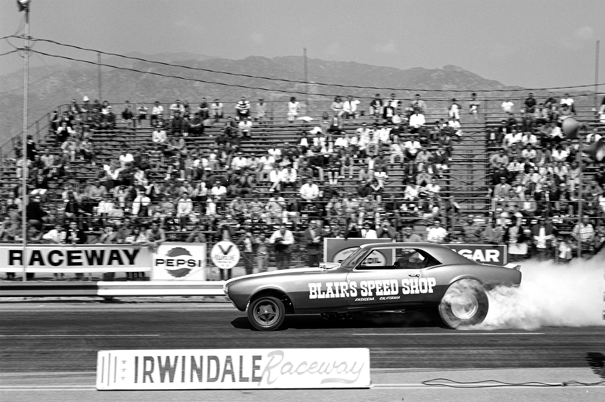 "Launching at Irwindale Raceway in March 1967, an early shot of the Blair's Camaro Funny Car was typical for the era, with some unique features like torsion bars front and rear, and a driver's door, as the body was heavy to lift from thick fiberglass used back in the day. Says Pete Poland, ""Our biggest moment of glory was in 1967 at Cecil County for the Super Stock Nationals, where we beat Jack Chrisman at 2:30 a.m. to take the XSX title."""