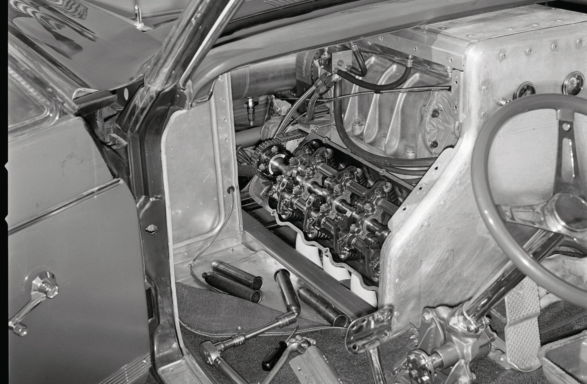 This was Jack Chrisman's take on the A/FX evolution revolution in 1965. Extreme engine setback, supercharger, and a jug of pop differentiated his Cyclone from Dyno Don's. The half-in, half-out Cammer led to flip-top fiberglass bodies for ease of maintenance as well as lighter weight, as can be seen in this shot.