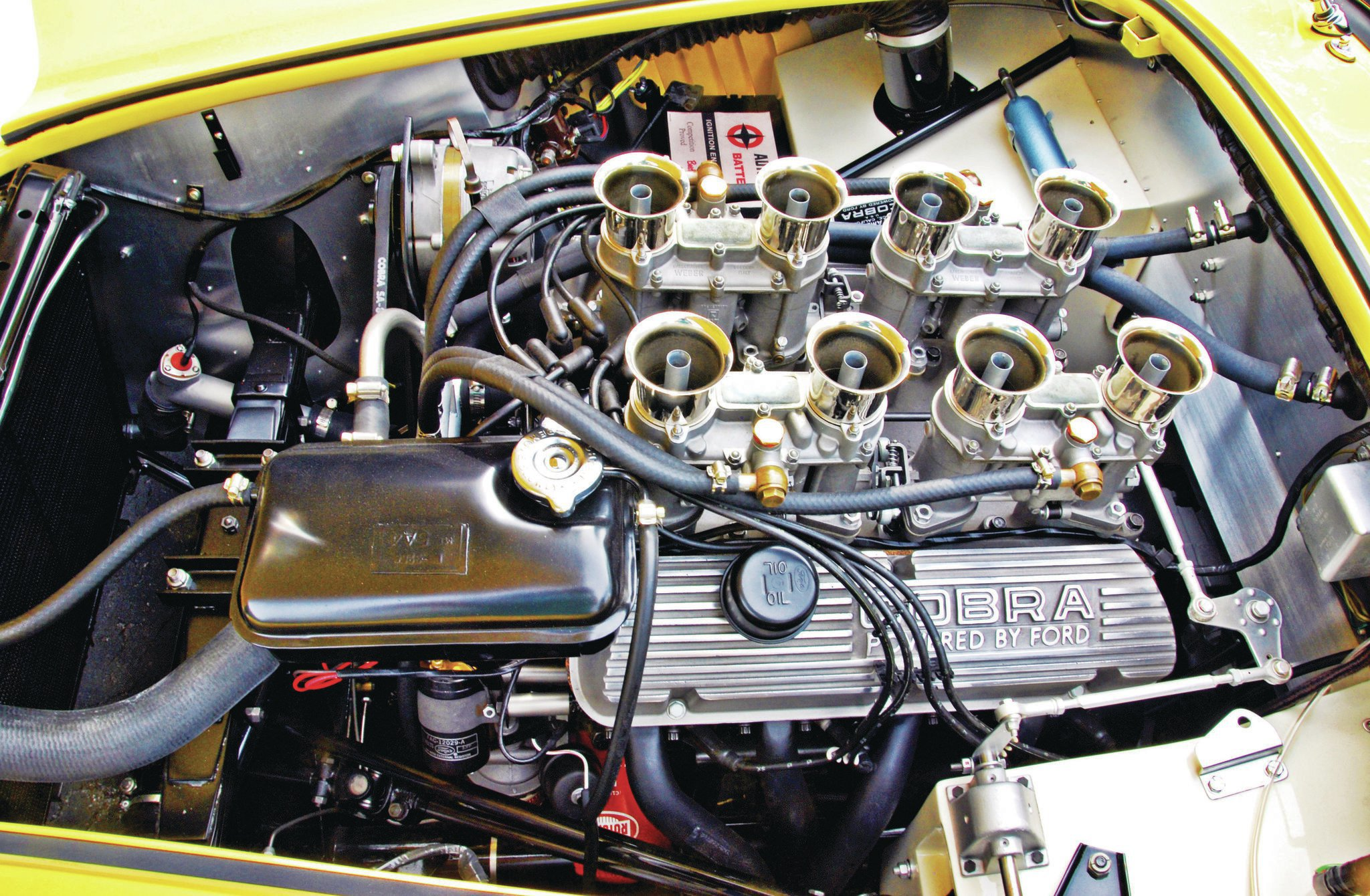 The Shelby Dragonsnake Phase III treatment brought a quartet of 48mm 2-bbl Webers into the mix. This is the only factory Cobra sold to the public that received this multi-carb treatment and powered the Shelby to sub-12-second quarters.