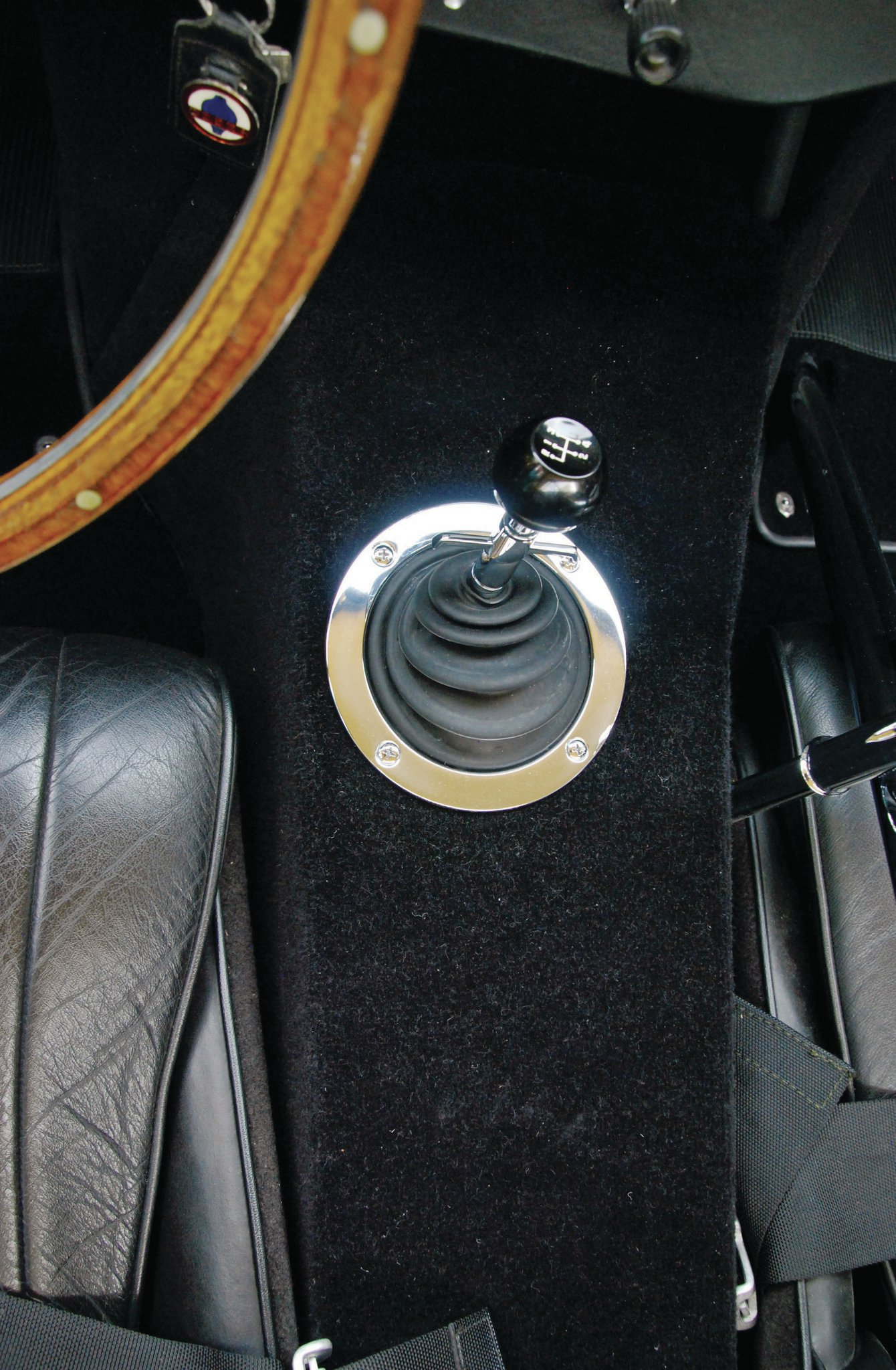 Inside, the interior is all basic street Cobra. Steve decided not to restore the original gauges, and respectfully left the yellowed lettering. The carpet is an NOS piece that the owner himself found in the UK on a parts-hunting mission. The chrome rollbar was a Stage III option.