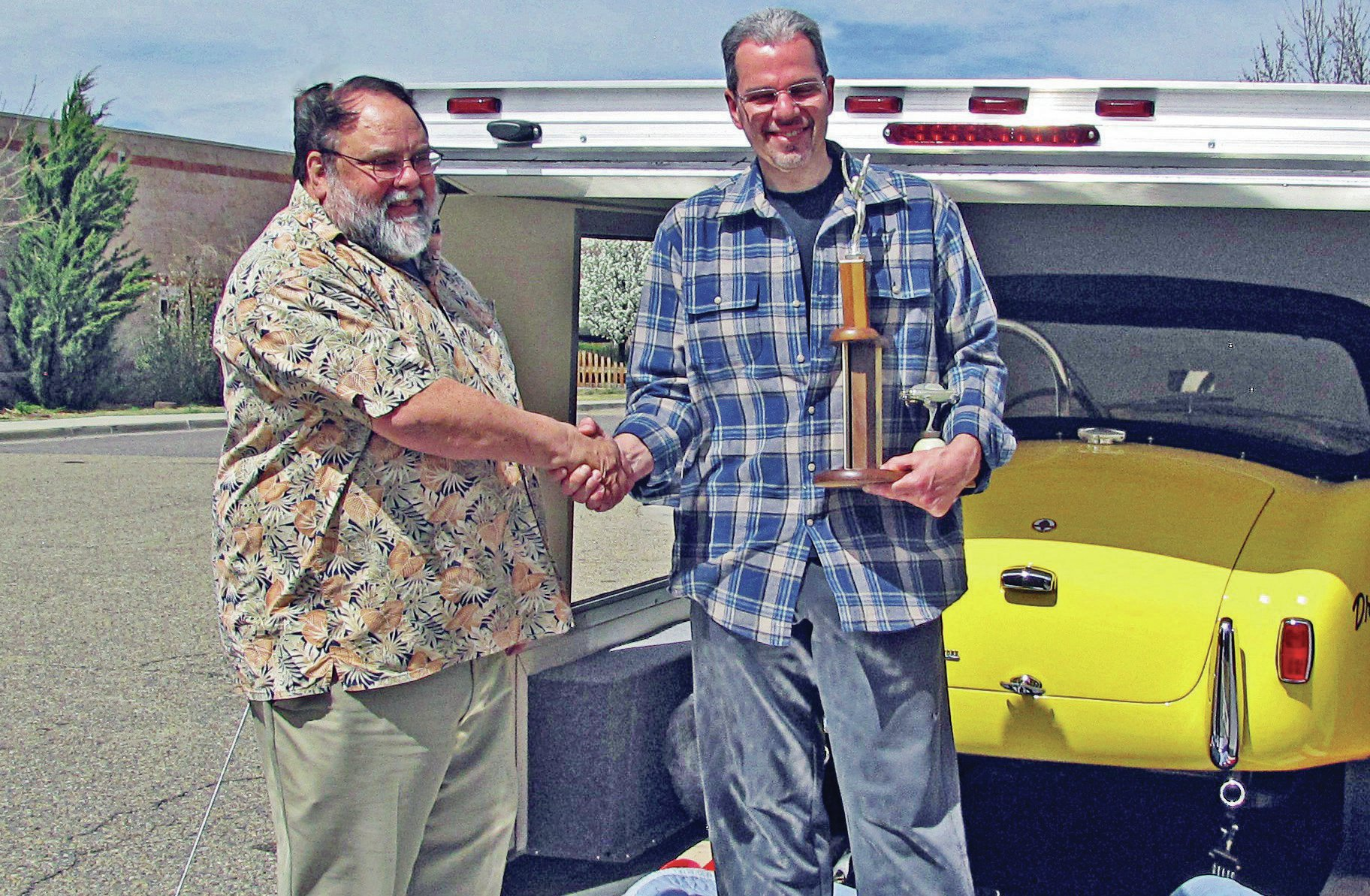 Present owner Steve Juliano (right), next to Mike Reimer, took a restored car and re-restored it to impeccable standards. His secret weapon: his massive stash of NOS parts. Searching out these rare parts is Steves's specialty, and restoring a car to these standards is his passion. Small-block Cobra guru Dan Case helped Steve push the Dragonsnake to become the highest-scoring Cobra in SAAC judging history.