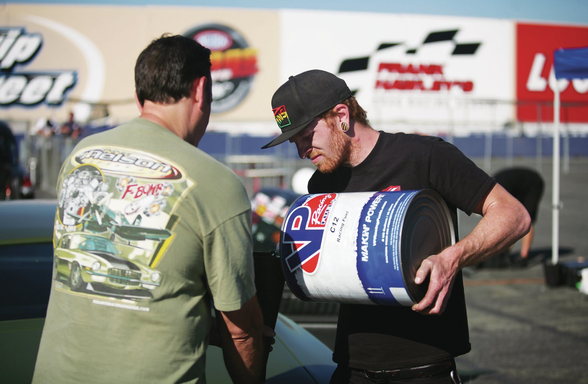 Tom Nelson (left) of Nelson Racing Engines was on hand to tune the F-Bomb and add some C12 race gas when the boost got turned up.
