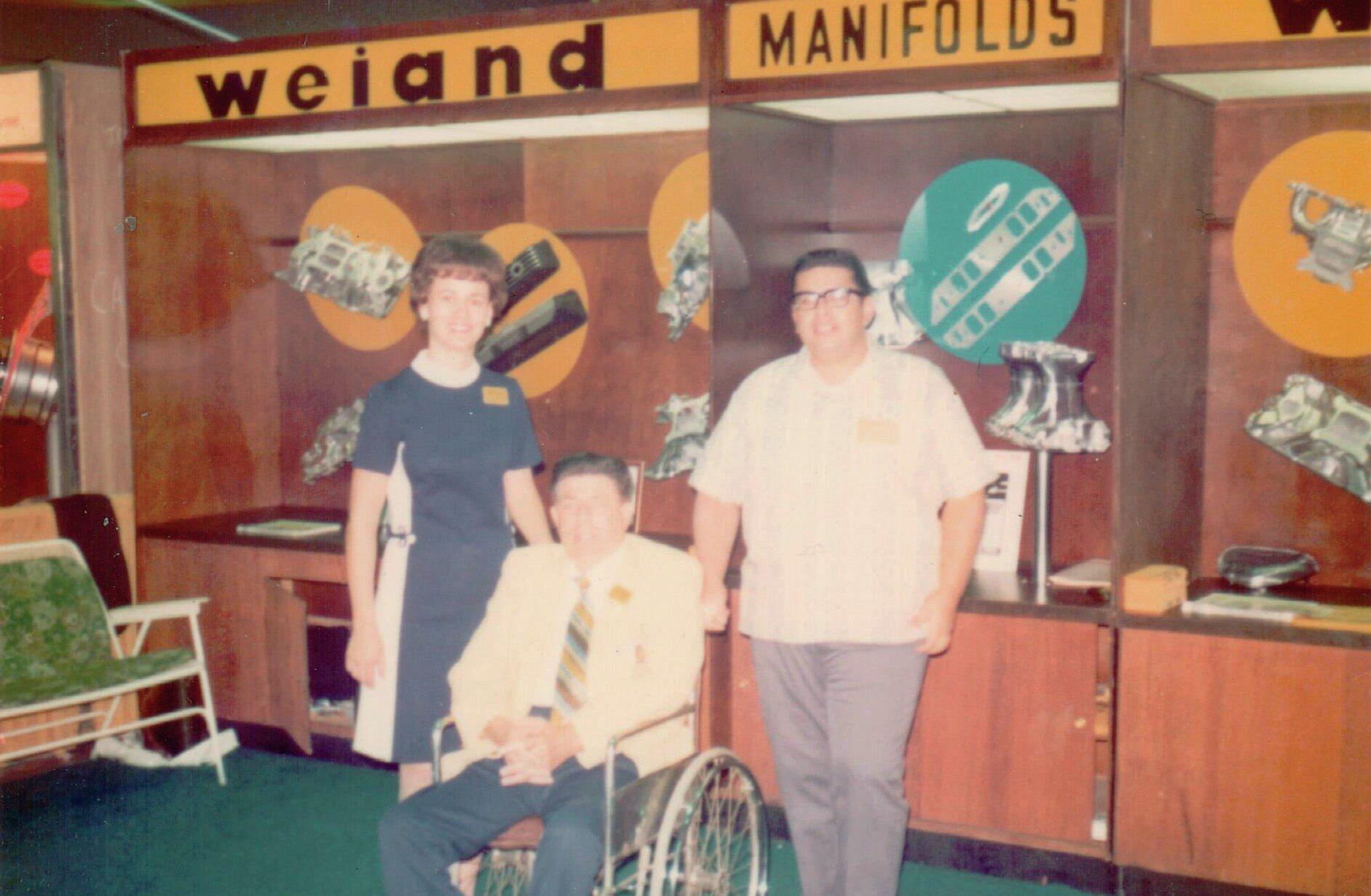 The Weiand booth at Anaheim SEMA: From left: Joan Weiand, Phil Weiand, and Weiand salesman and NHRA Pontiac Stocker racer Richard Salcedo.