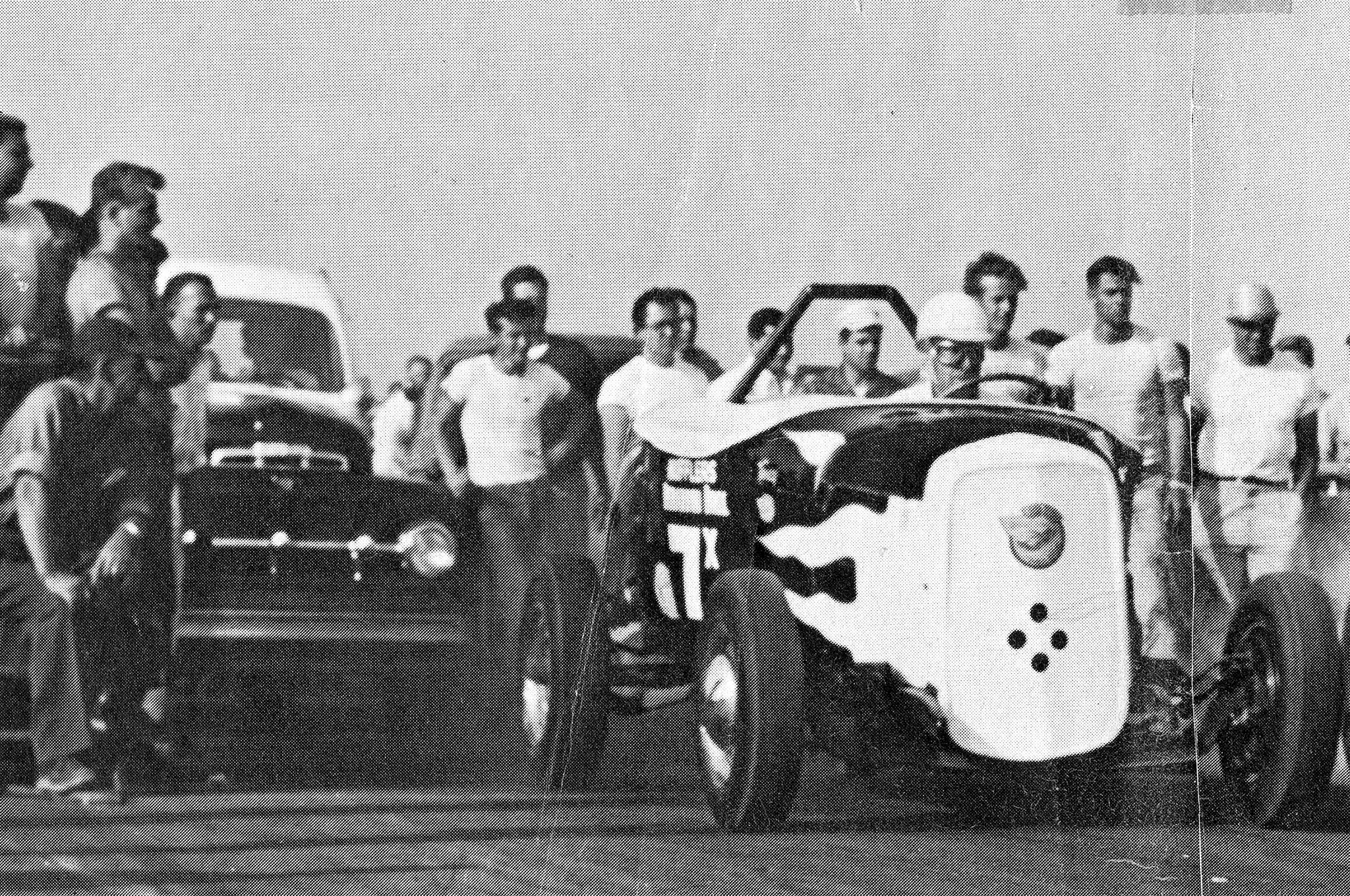 Leslie Long took this photo of the roadster and the Berardini push truck at the Santa Ana drags. Pat's daughter Susan turned it into a poster, and she provided this rendering for our story. Tony is driving the roadster, Pat is driving the push truck, and seated in front of the crowd is Nick Harrell, who built the engine for Pat's Deuce.