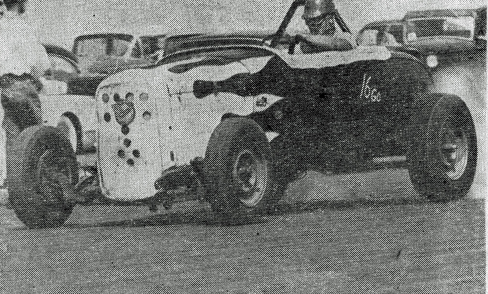 """Drag News ran a photo of the roadster in 1956 with Willie Borsch at the wheel. Now owned by Jim Harrell, the car was in transition—still sporting the trademark Berardini flames, but now powered by a Chrysler overhead mill instead of the flathead. The caption read, """"Open Gas O.H. entry of Borsch & Harrell blasted class record at Santa Ana March 16 with torrid run of 123.45. E.T. of 11.03 with 355 C.I. Chrysler."""""""