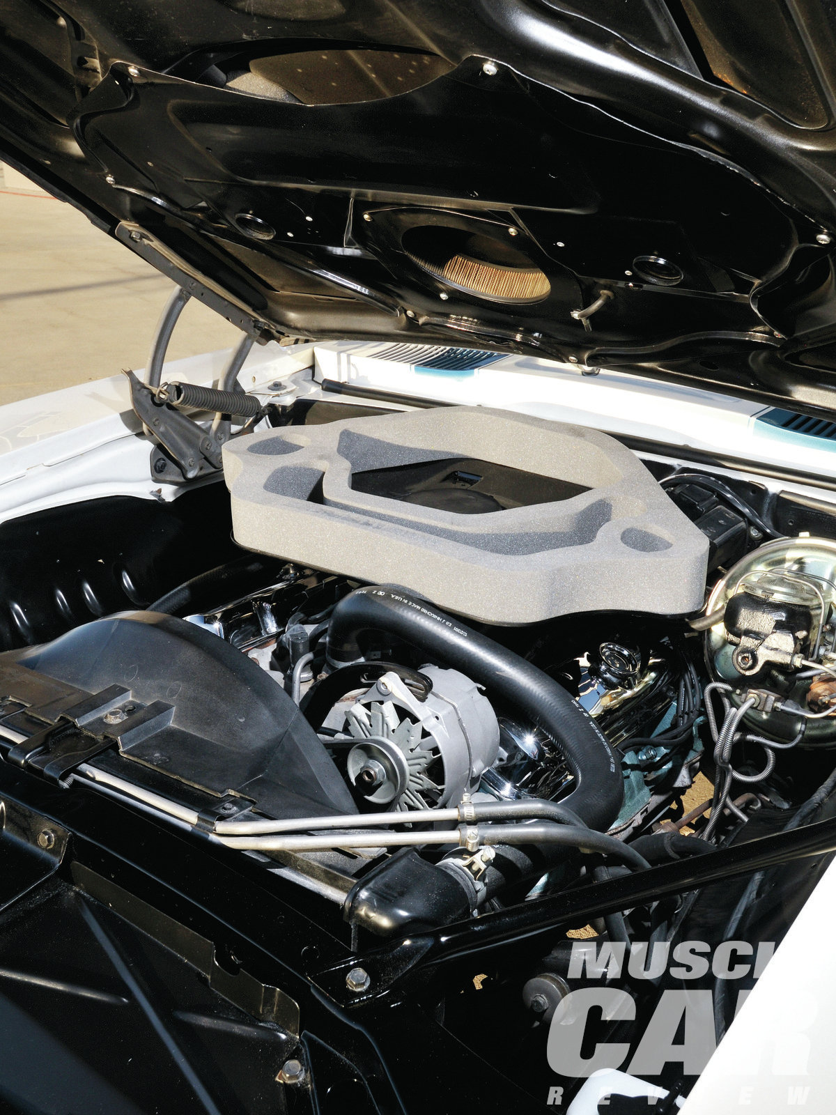 Foam around the air cleaner sealed the engine to the functional Ram Air scoops in the hood. Most Trans Ams were fitted with the 335hp Ram Air III engine; this is one of just 55 T/A coupes equipped with the more potent Ram Air IV mill.