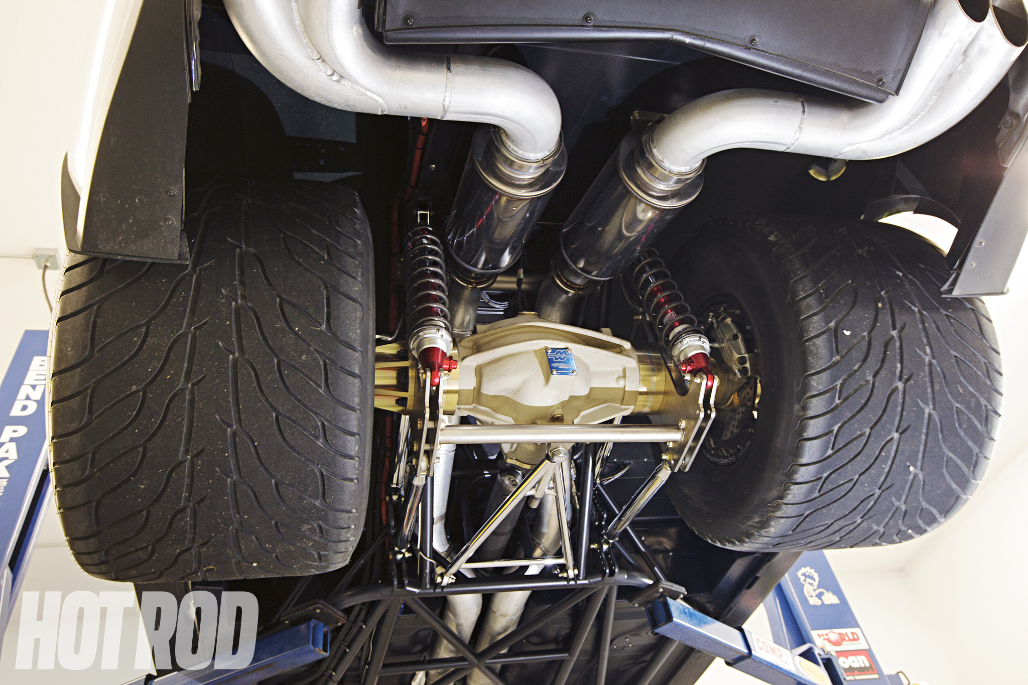 Once you get a look at this angle, it becomes apparent this is not a stock or even mildly massaged Camaro. Mark Williams Enterprises full-floater axle spins 33/22.50-15 Hoosier hoops on 15x15-inch M/T billet wheels. All of this is suspended by a Larson four-link and Santhuff coilovers, and tied to the front suspension. The 4-inch stainless exhaust ends with the stock ZL1 tips.
