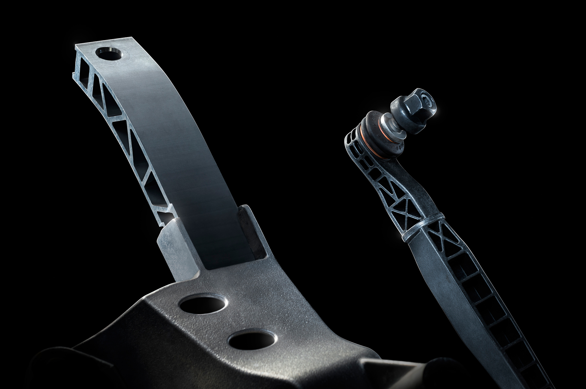 Greater use of aluminum suspension components further contributes to the Camaro's weight loss – and they even honeycombed some of the suspension links for further savings. Overall, suspension weight is reduced by 26 pounds.