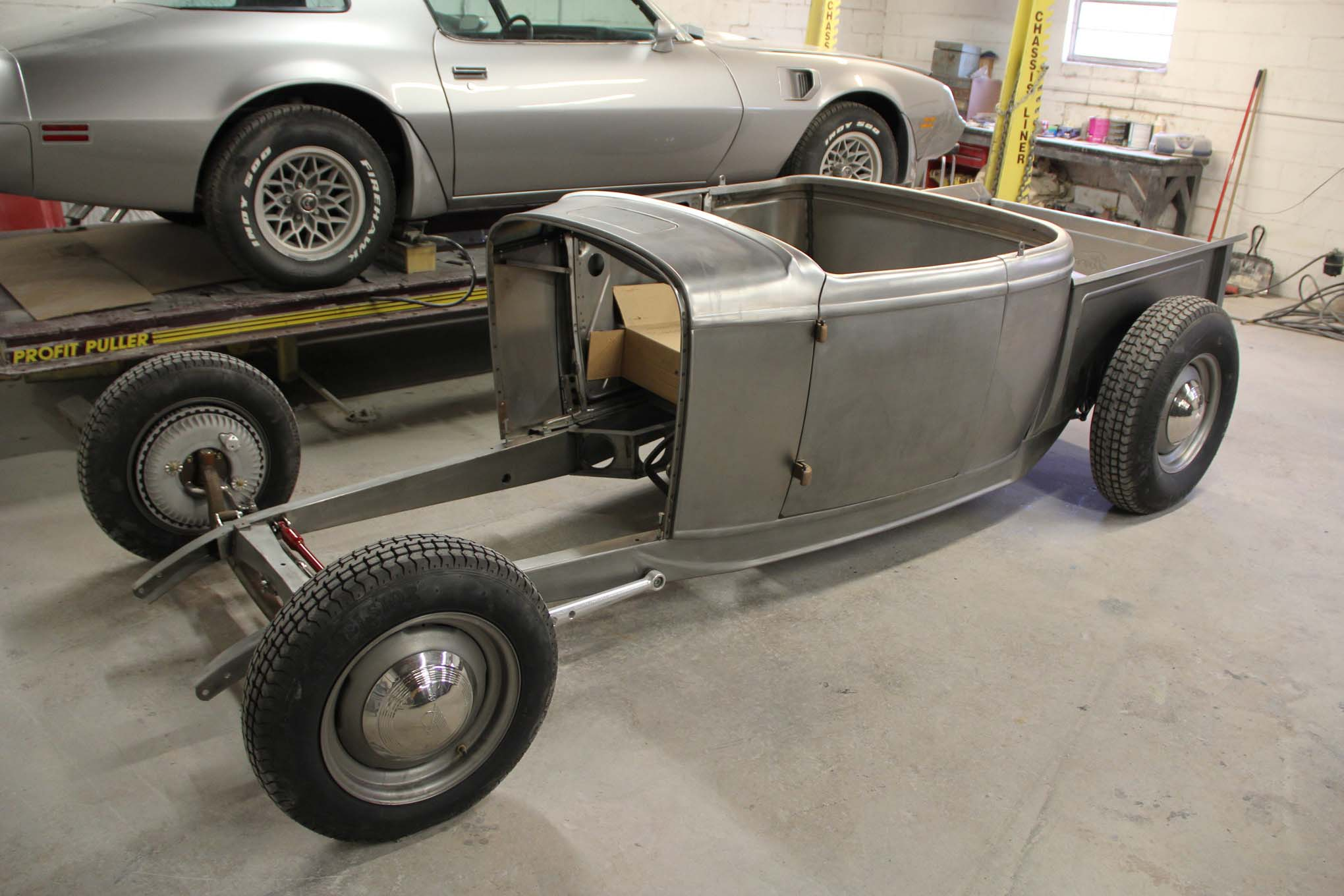 They do roadsters too. This 1932 pickup has a Brookville body and split radius rods on 1932 rails, so far.