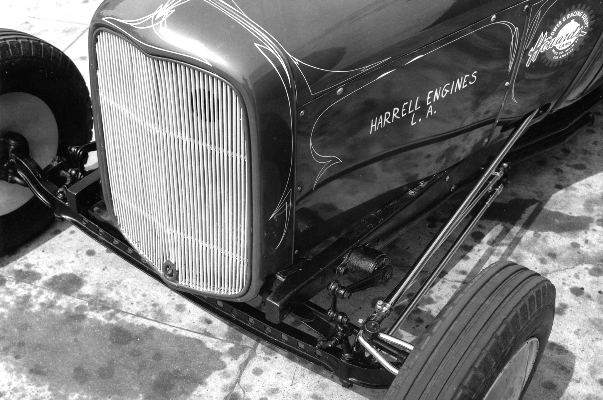 """Front axle is a drilled Model A piece located by tubular radius arms. Steering arm was by Cragar. """"Pin striping around 1932 grille gives a neat contrast,"""" wrote HRM."""