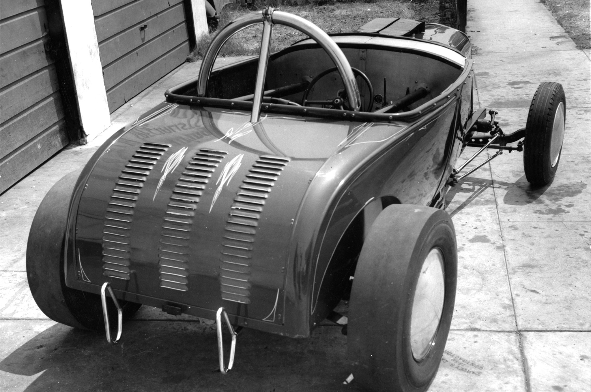 Between the Inglewood slicks was a Halibrand quick-change with 3.78 gears. The rest of the driveline consisted of a Schiefer clutch, '38 Cadillac transmission, and a closed Ford driveshaft.