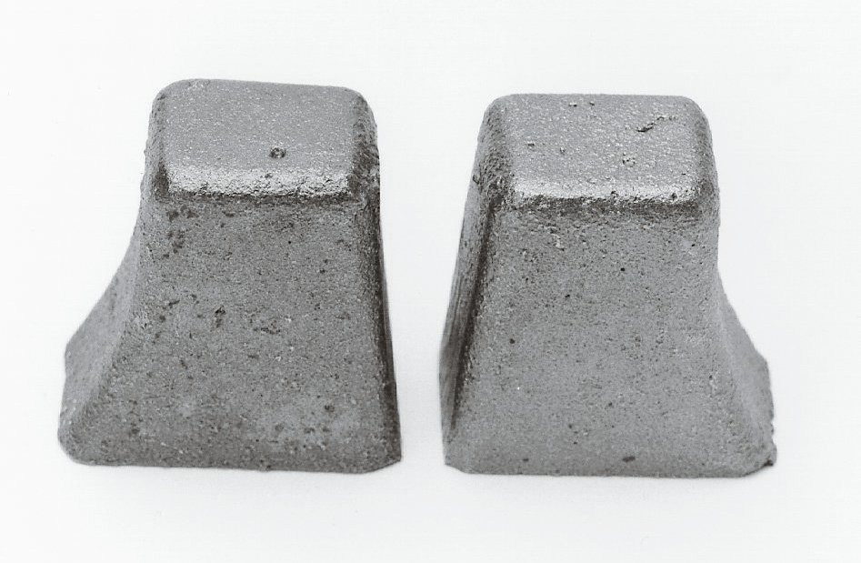 These are the cast-iron plugs that are installed in the head's heat riser passages to prevent the intake manifold from cracking.