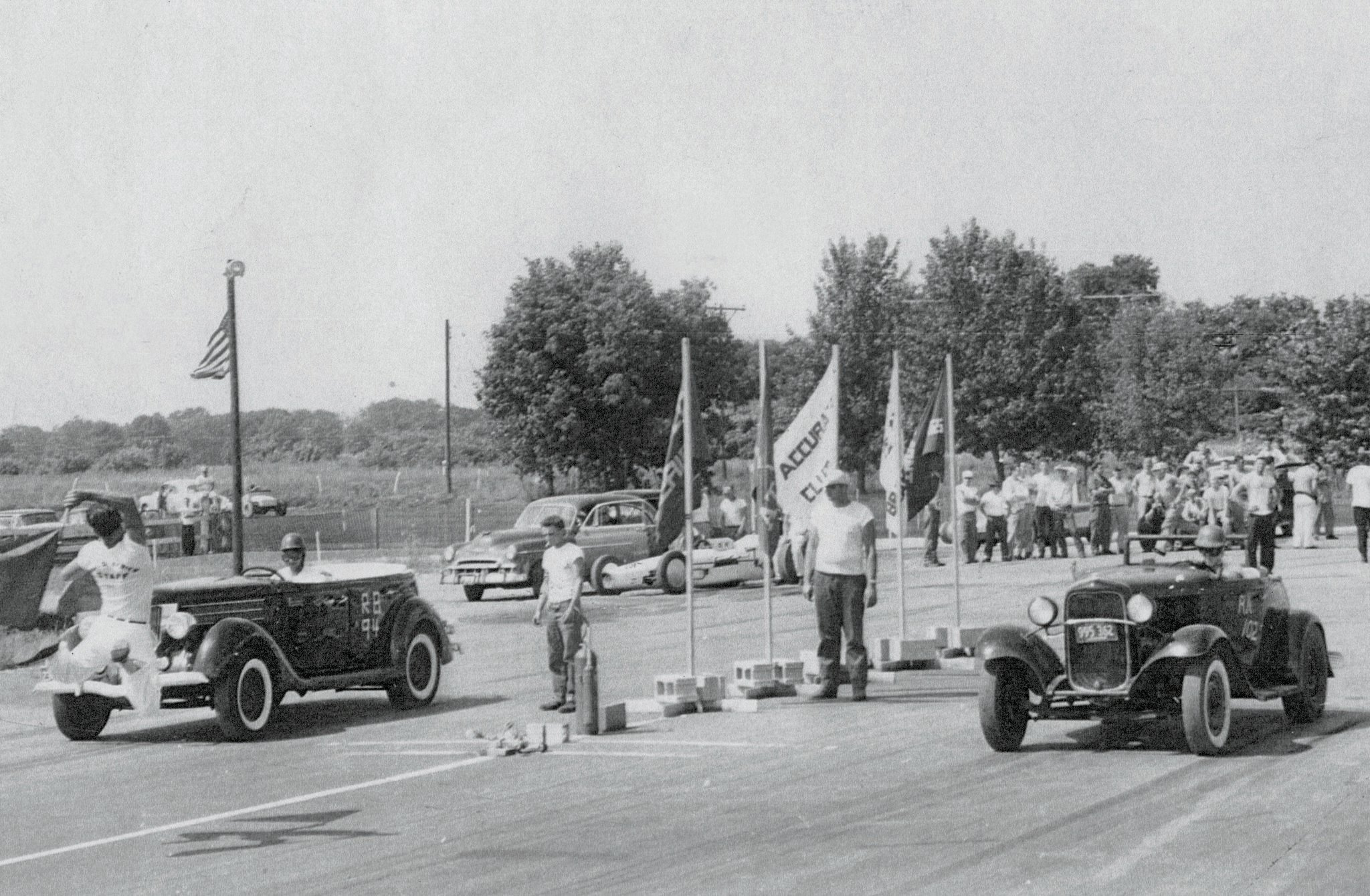 Chicagoan Chris Karamesines in his 1936 Ford Phaeton goes up against another topless competitor at the new dragstrip in Half Day, Illinois, in 1952.