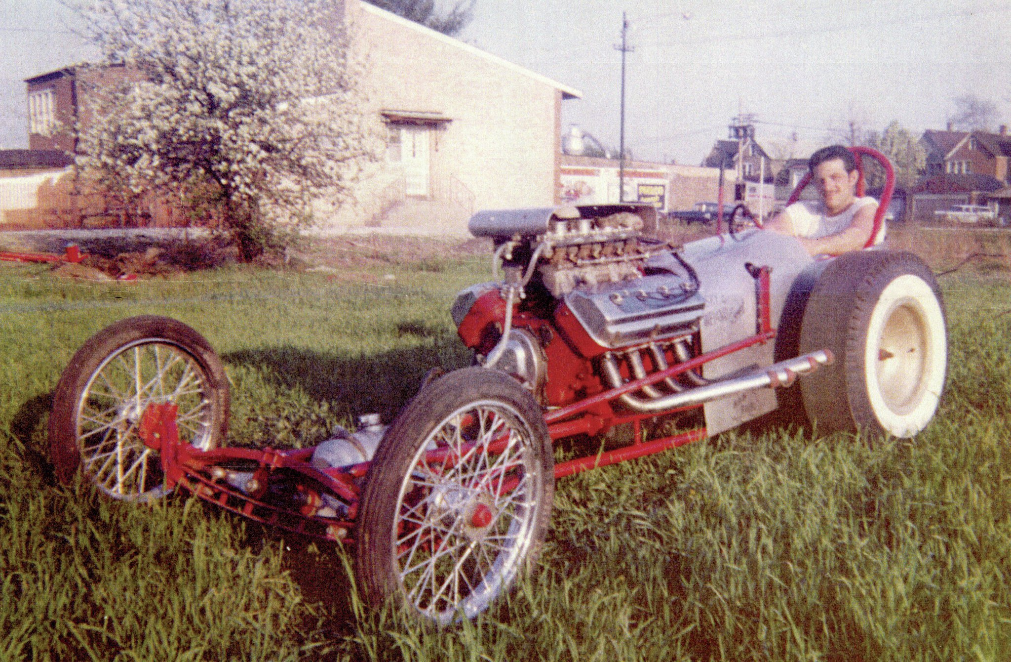Karamesines built his first dragster in 1955 and posed with it next to his home. A carbureted Chrysler on nitromethane provided power for the 88-inch-wheelbase, homebuilt rail. Whitewalls and bright-red paint made it a luxury ride.