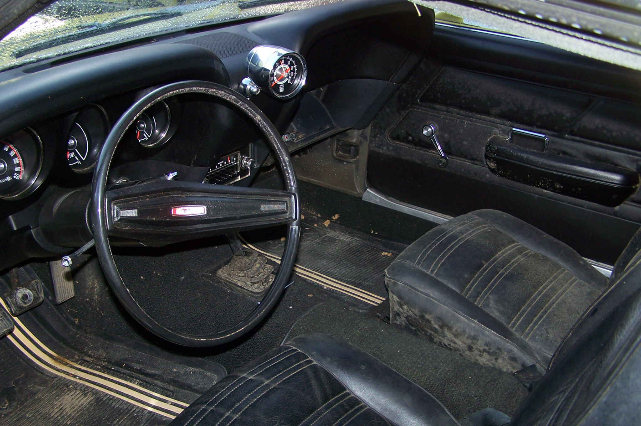 "The interior was all original and mint. The tachometer is a ""Day Two"" modification. The odometer read just over 26,000 miles."