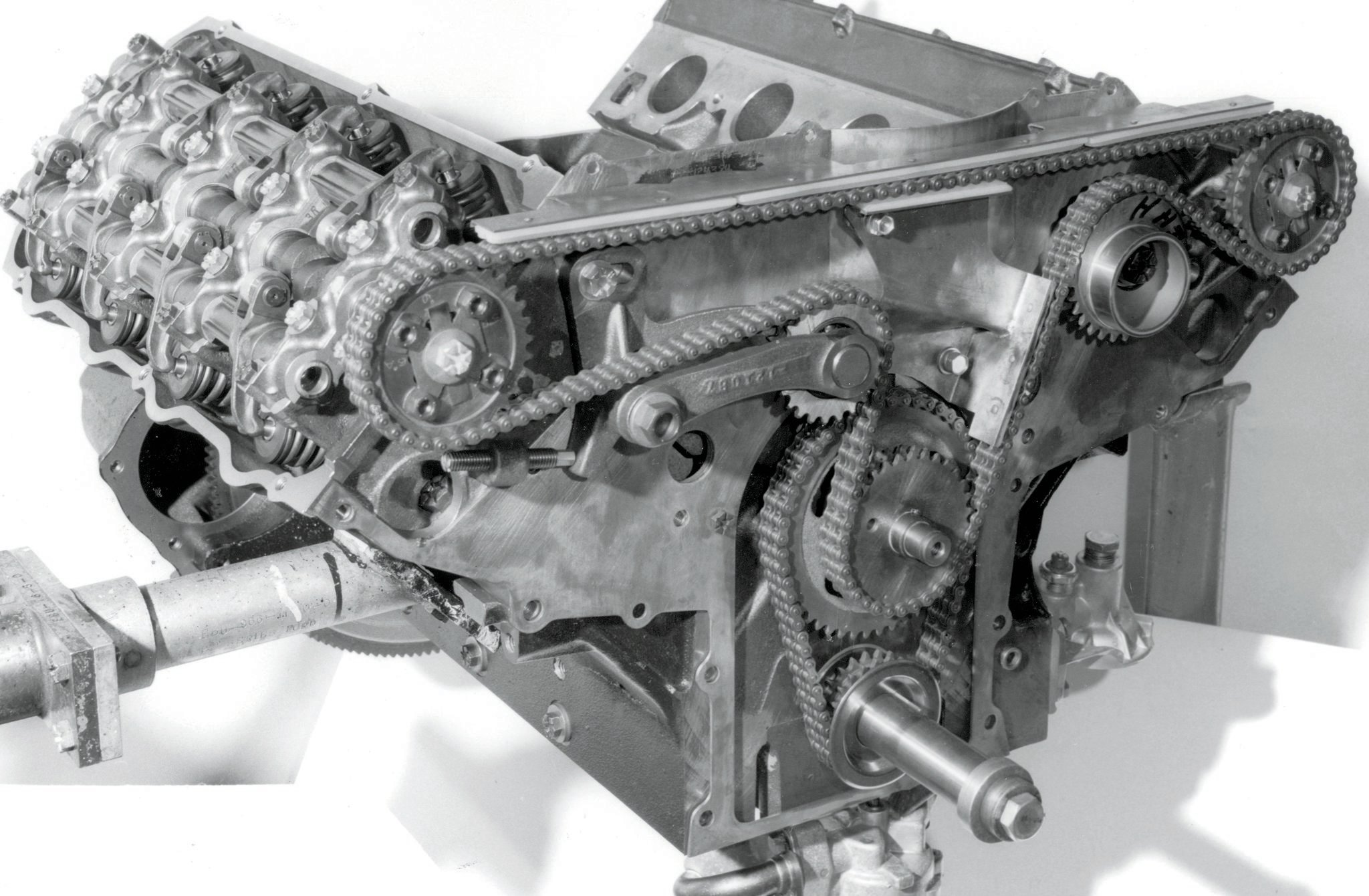 """Ford's SOHC was based on the FE engine family and featured a single camshaft atop each large-port, hemispherical combustion chamber cylinder head. Cams were driven by double-row chains, which were fine for the original NASCAR application, but the pressure brought by a supercharger caused micro chain clearance """"stack-up"""" or stretching, which retarded cam timing and promised blower explosions and fires."""