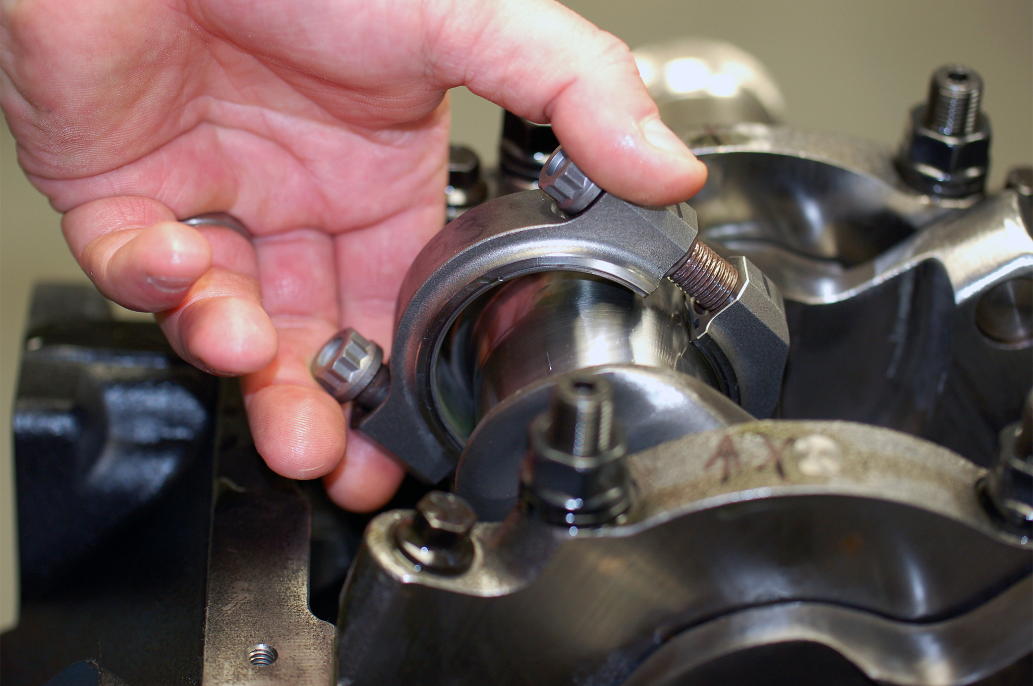 When installing your rods and pistons, be very careful with the edges of the rods and caps. There are sharp edges that can scratch and gall the crank or cylinder surfaces.