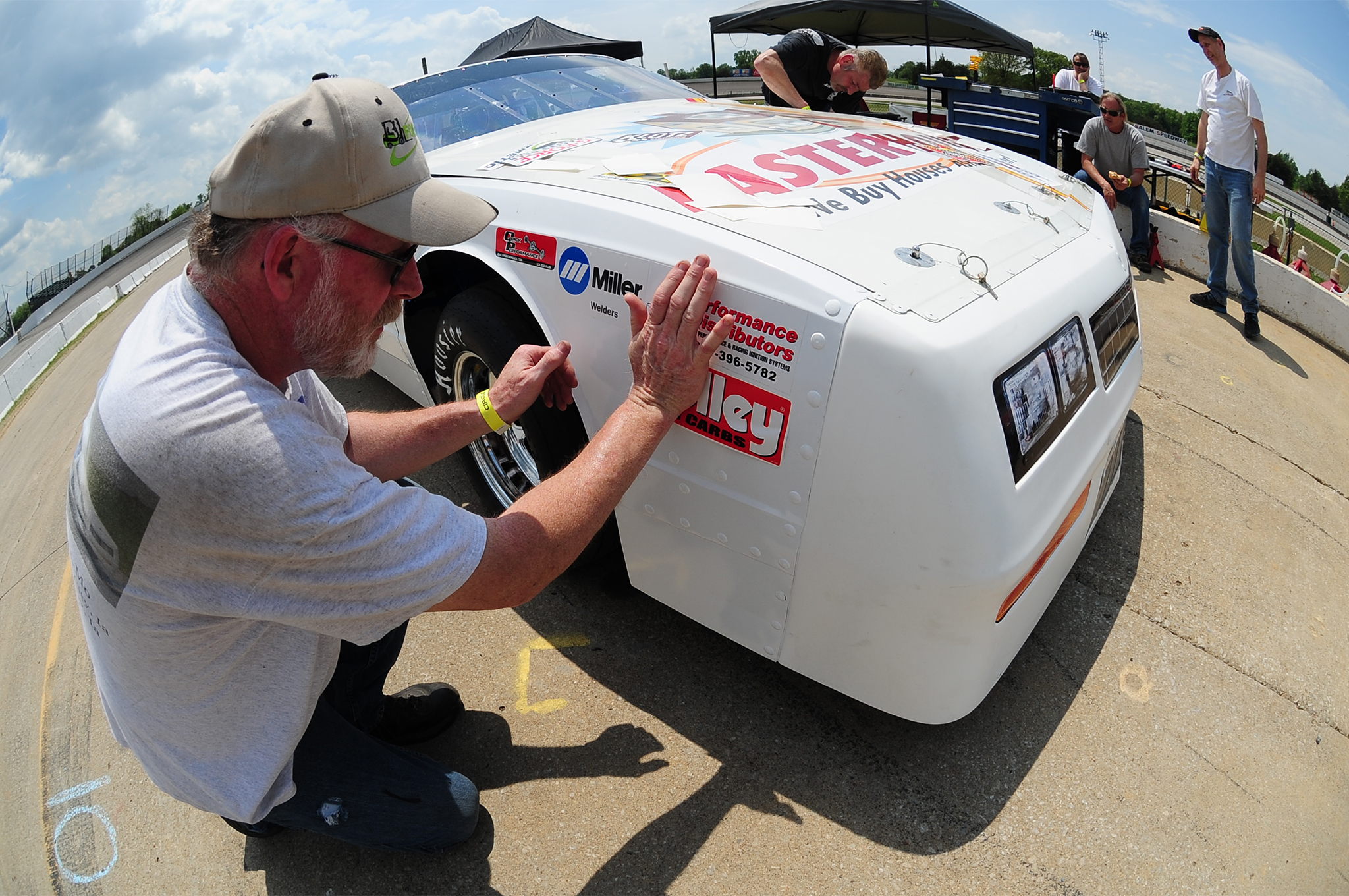 Official product sponsor decals are affixed to the front of each competing car.