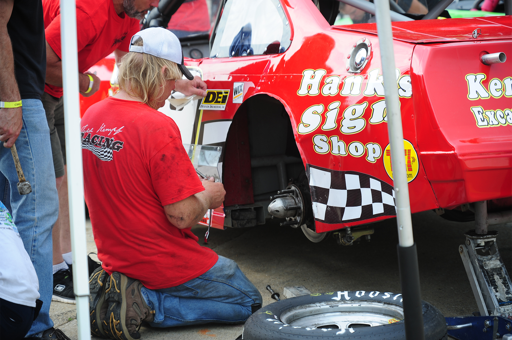 Todd Kempf, who is the current Salem Speedway Street Stock division points leader, works on the rear end of his car. Kempf would ultimately finish Fourth in the main event.