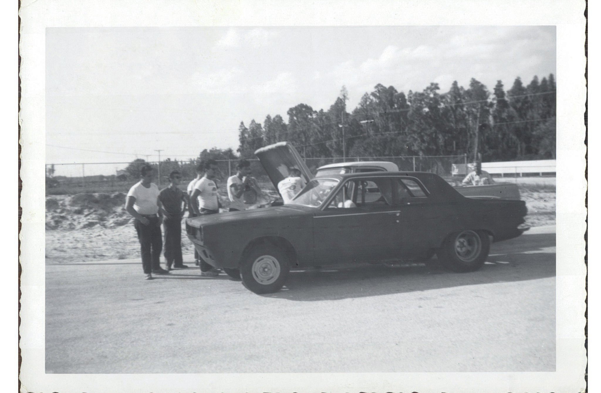 A number of onlookers check out the first Dart prior to the shakedown run that was documented by a film crew that Chrysler had sent to Florida.
