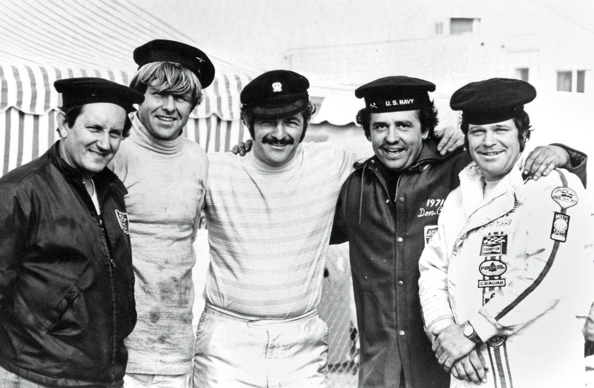 """The Greek Fleet was a close-knit cadre of Top Fuel racers who often appeared together. Karamesines, the Rear Admiral, assigned ranks based on performance or whimsy, as it suited him. Left to right: Bob Creitz, """"Kansas"""" John Wiebe, Chris """"The Greek"""" Karamesines, Don """"Mad Dog"""" Cook, and Jim Nicoll."""
