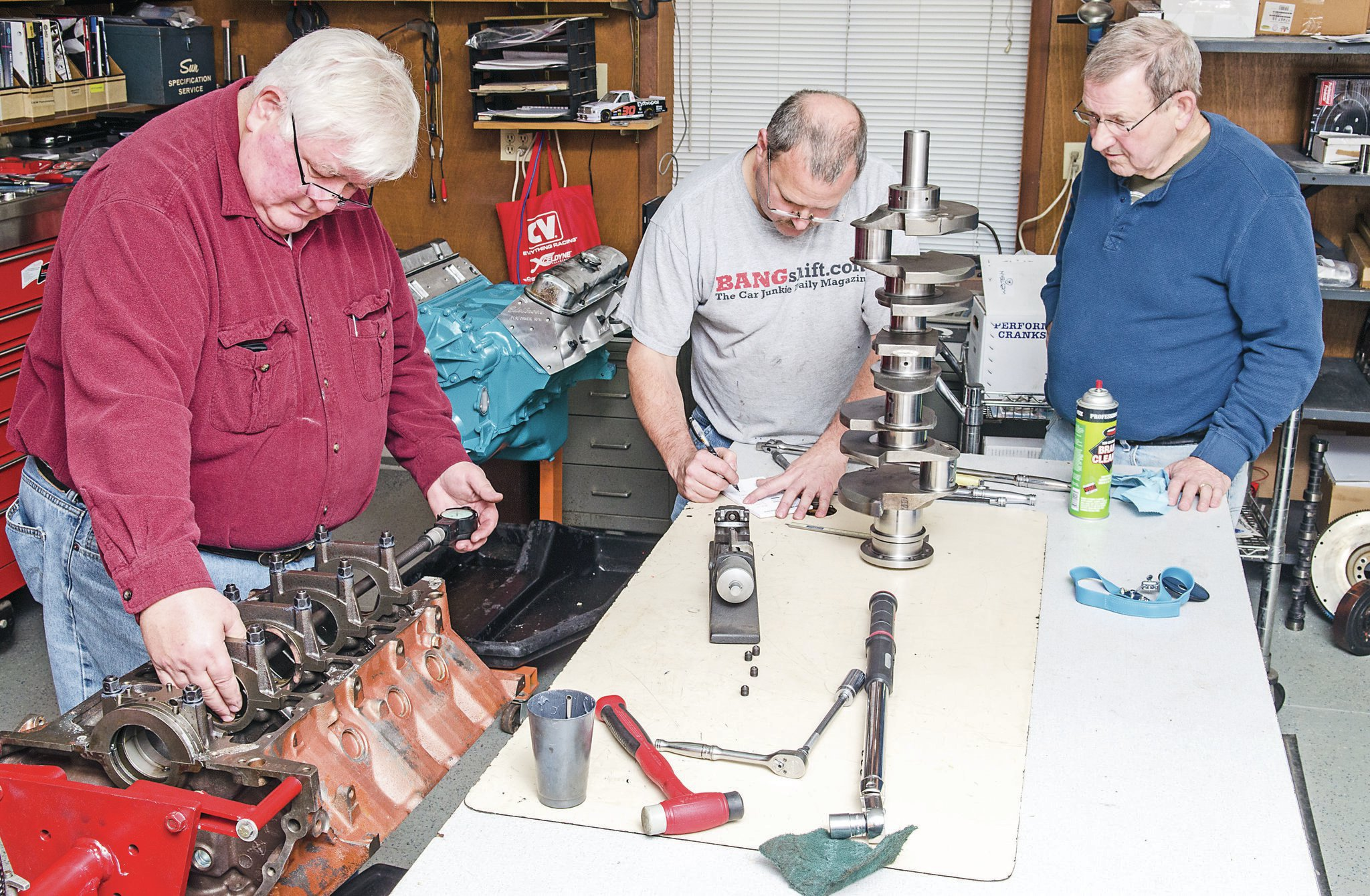 Westech Automotive rescuer Norm Brandes (left) schools Rob and Rob's brother, Tim, on proper big-block Olds bearing clearances.