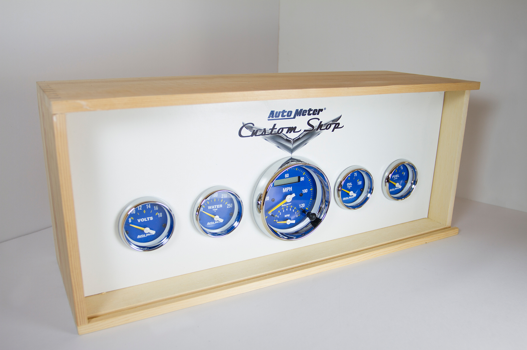 When your Auto Meter Custom Shop gauges show up, they'll come in a custom wood presentation box with a heat-burnished label. Custom colors for faces and needles are hand painted, all gauges are hand-assembled, and everything is made in the USA.