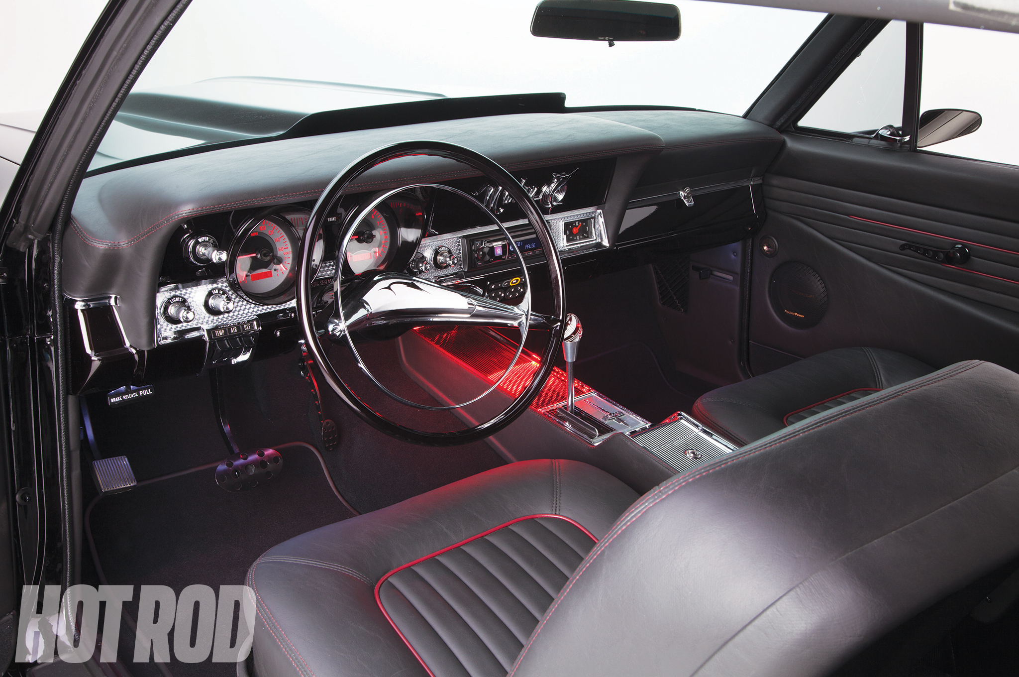 The dash sheetmetal is factory, although now it's filled with Dakota Digital custom analog gauges. A 1954 Pontiac steering wheel was cut down to 15-inch diameter.