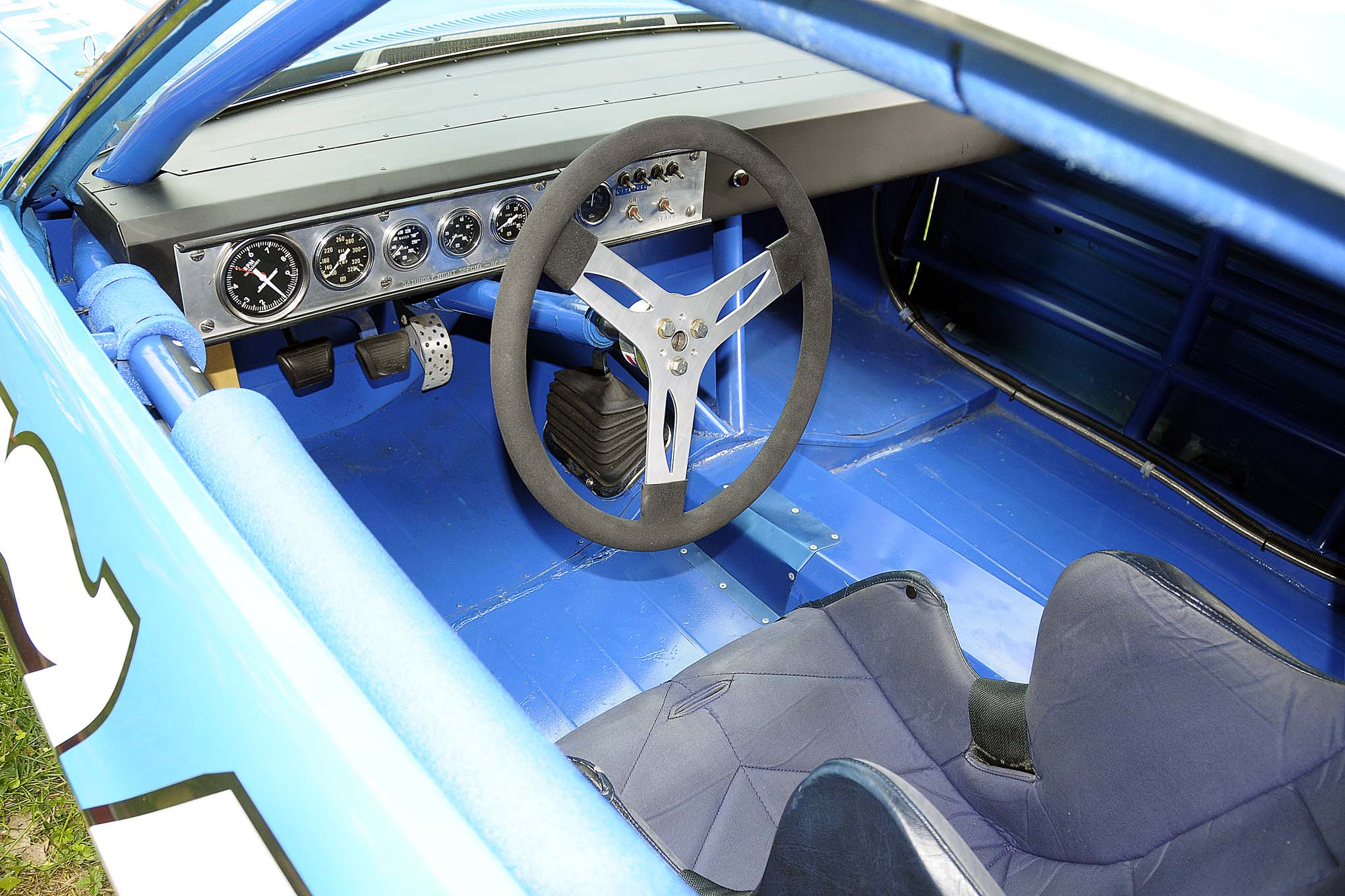 This view of the simple interior shows a steel floor and a complete lack of interior door panels.