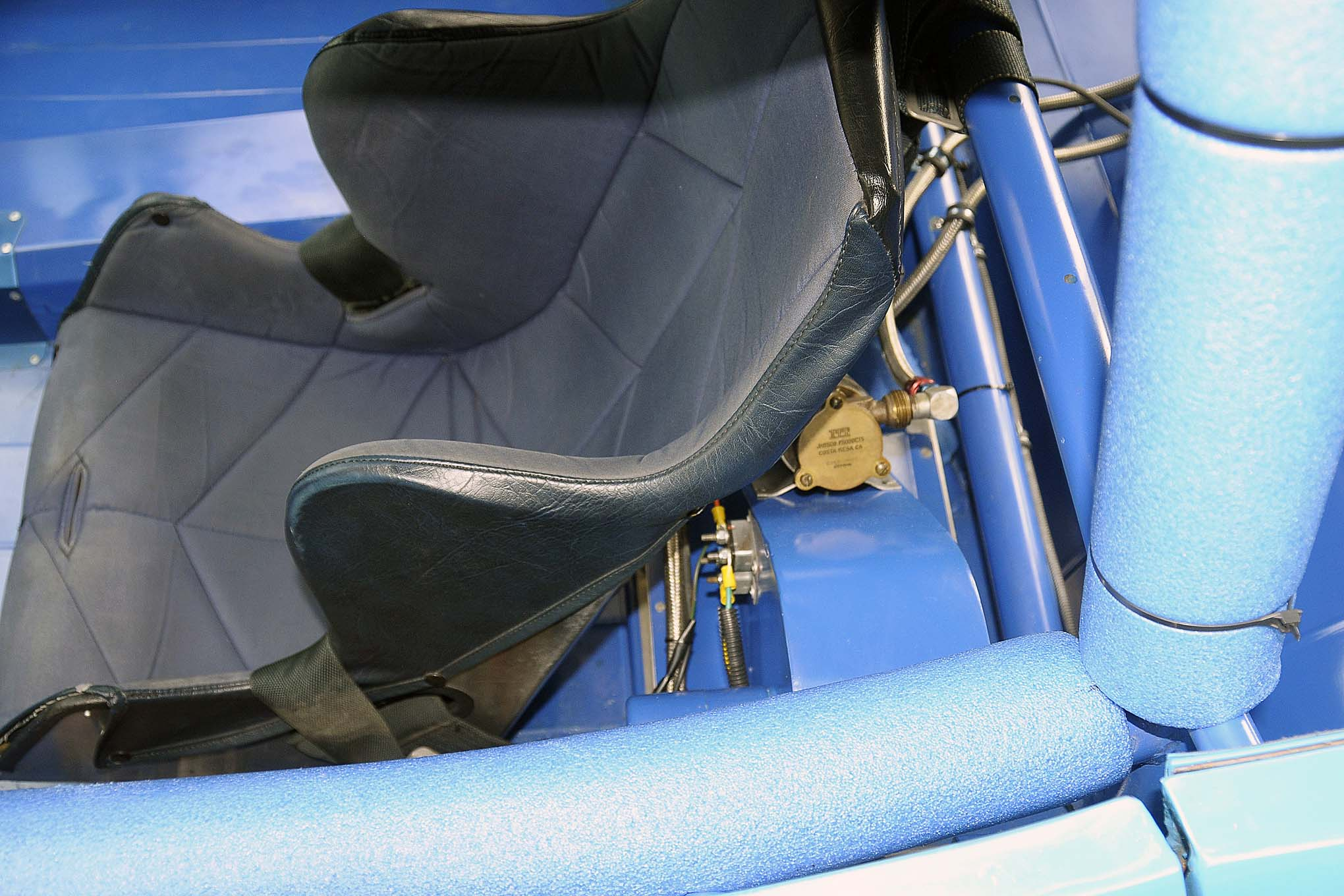 The racing seat, sans headrest, shows it to be mounted just as it was in the early '70s, bolted to the upper and lower rollcage bars.