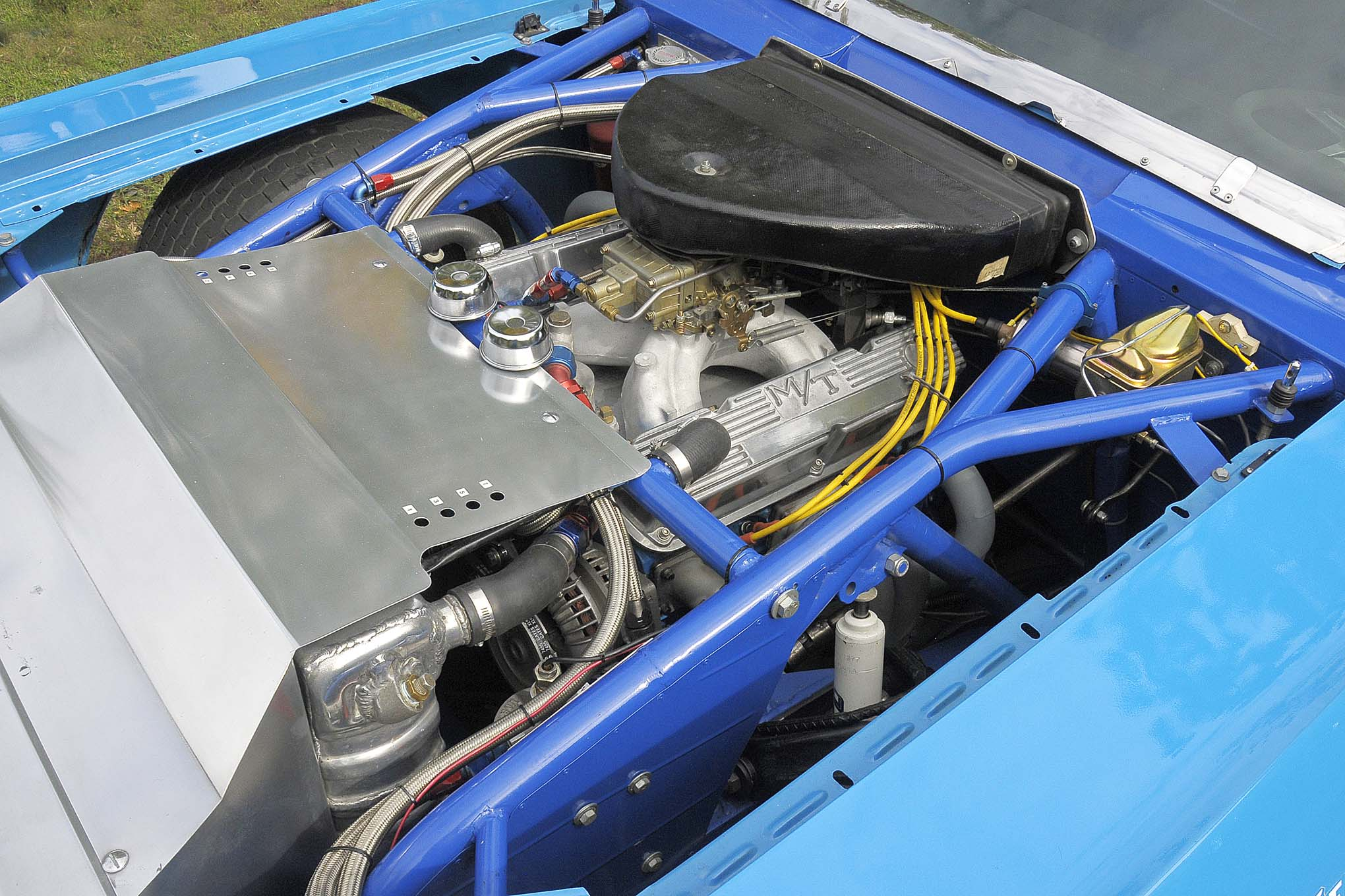 The elaborate aluminum ductwork funnels the outside air through the radiator. The engine is the period-correct W2 355 small-block capable of about 650 hp (roughly 300 less than the modern version of the same motor). Since NASCAR required small-blocks starting in the early '70s it made sense for this kit car to be offered with one.