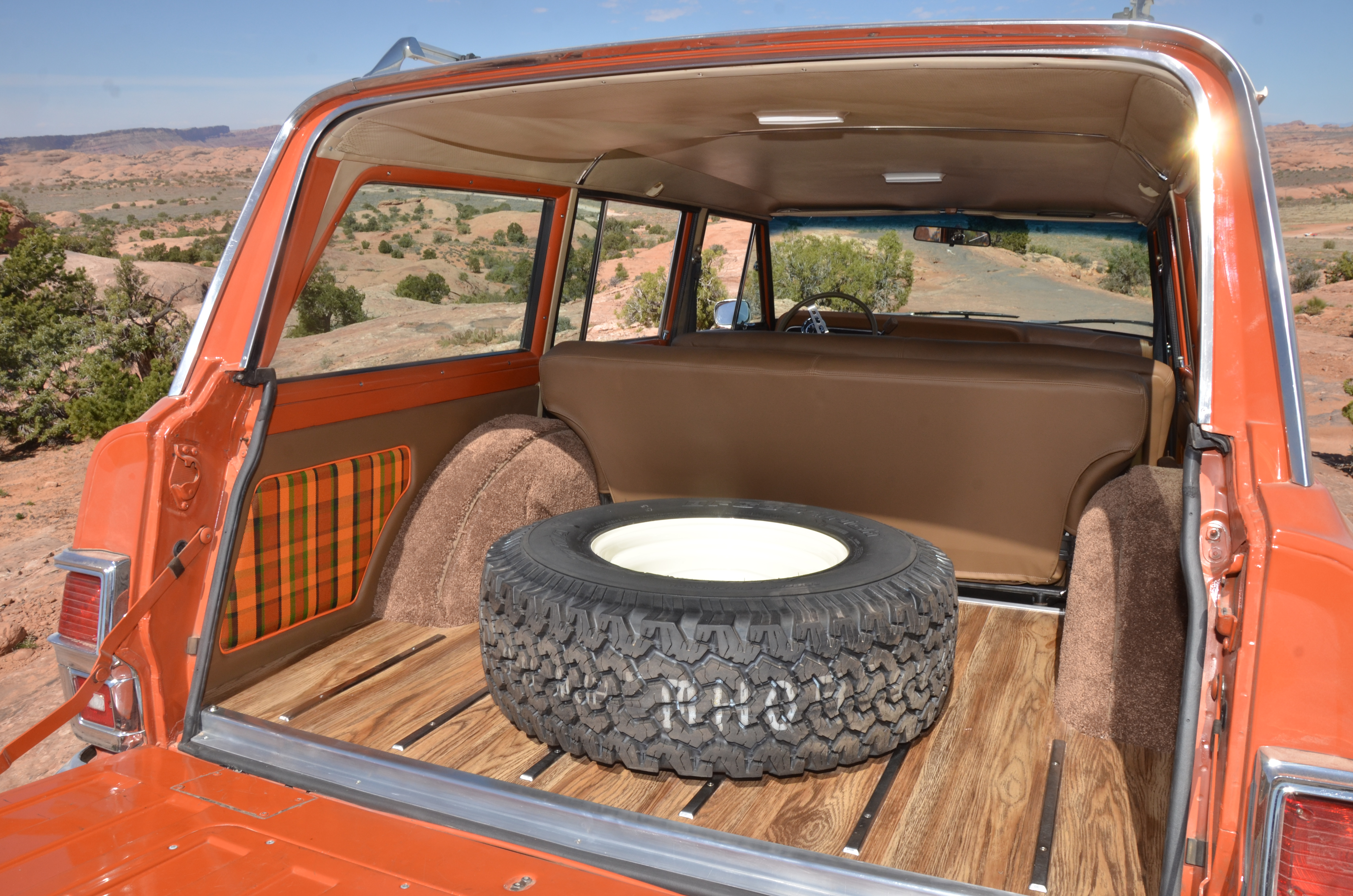 The spare tire is floor-mounted over vinyl wood that planks the rear compartment and is accented with chrome strips.