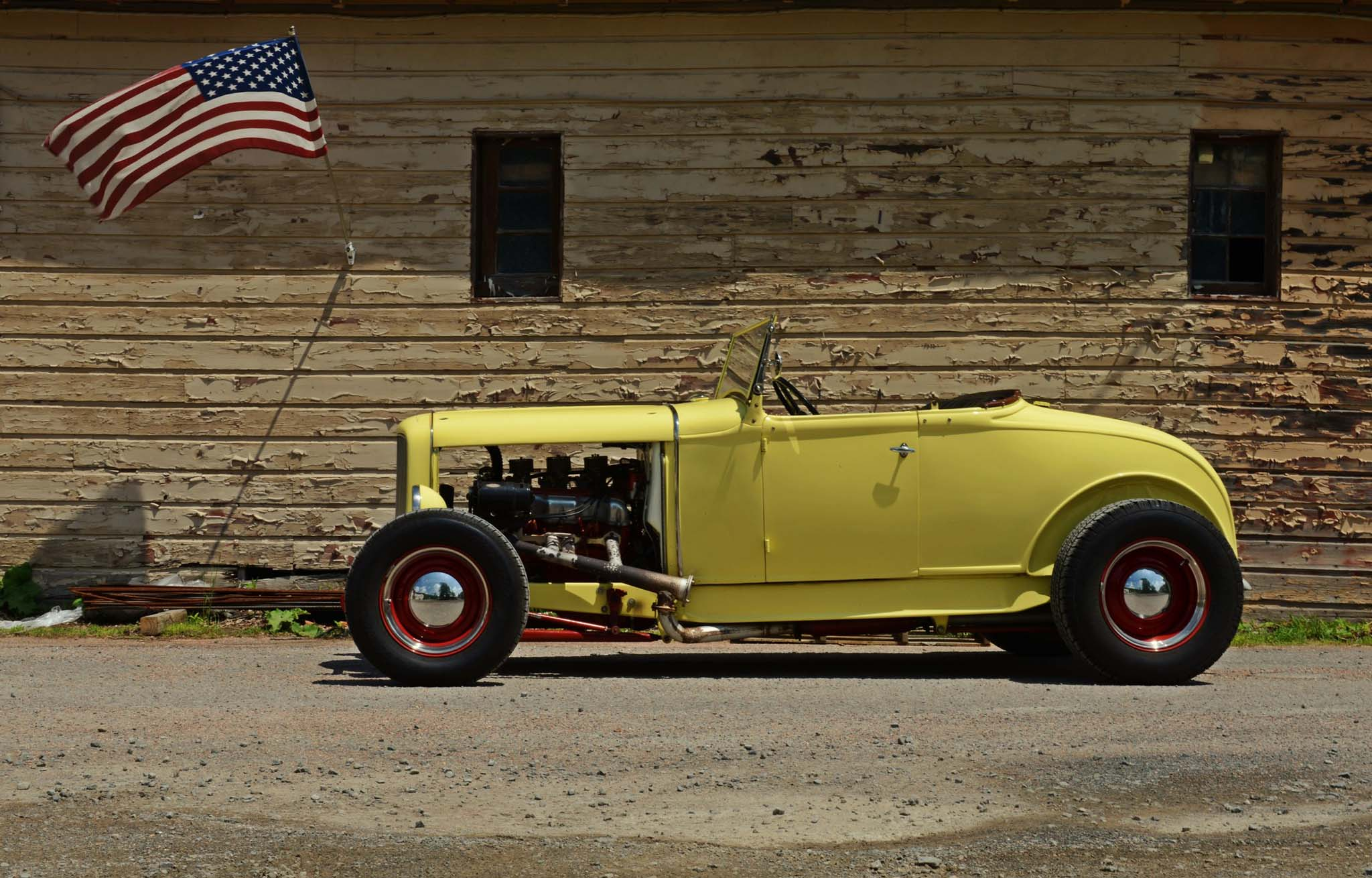 Dave built the 1930 out of a body he saved from a wrecking yard in Wyoming, and it's mounted on narrowed deuce rails. The hood is another one of Dave's custom touches—he hand-formed it from a Chevy S-10 piece.