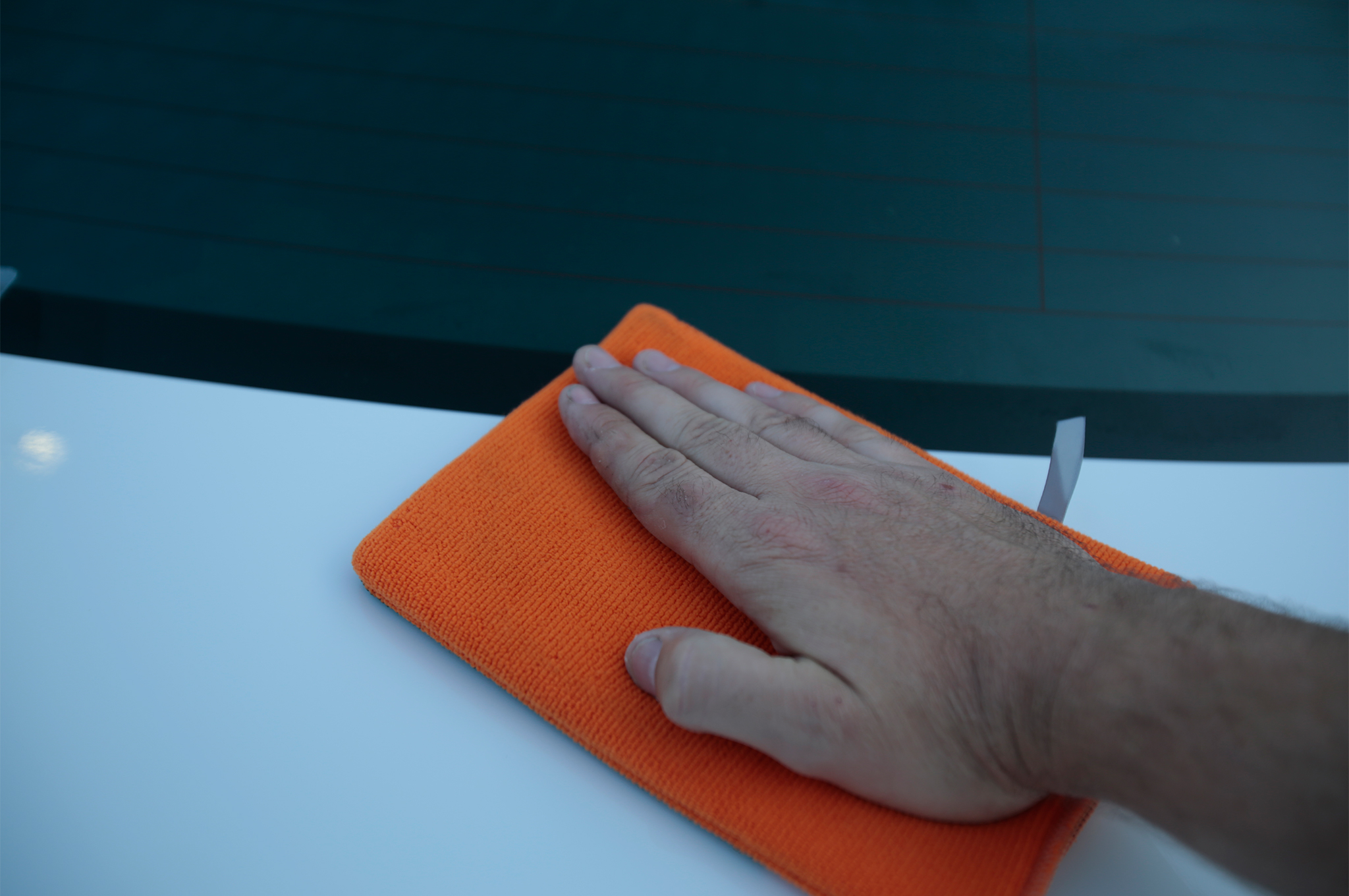 Just like a clay bar, use the mitt to polish the surface. We found that a light spray caused just a bit of drag, similar to the feel of a clay bar. Too much spray detailer and the mitt would just slide around without doing its job.