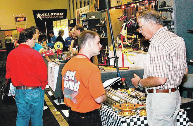 The always approachable Gene Coleman (right) talks with a racer at the PRI Show.