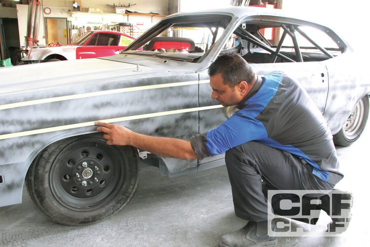 "8. ""The car can be a little wavy and still look good if the lines are straight. A car with no waves and straight lines looks great,"" says Santiago Andrede at Elite. Getting the bodylines straight is the secret to a great-looking paintjob. Here, Singh used tape on the Demon's four major bodylines. This is where an experienced painter makes the difference. The lines need to be laser straight."
