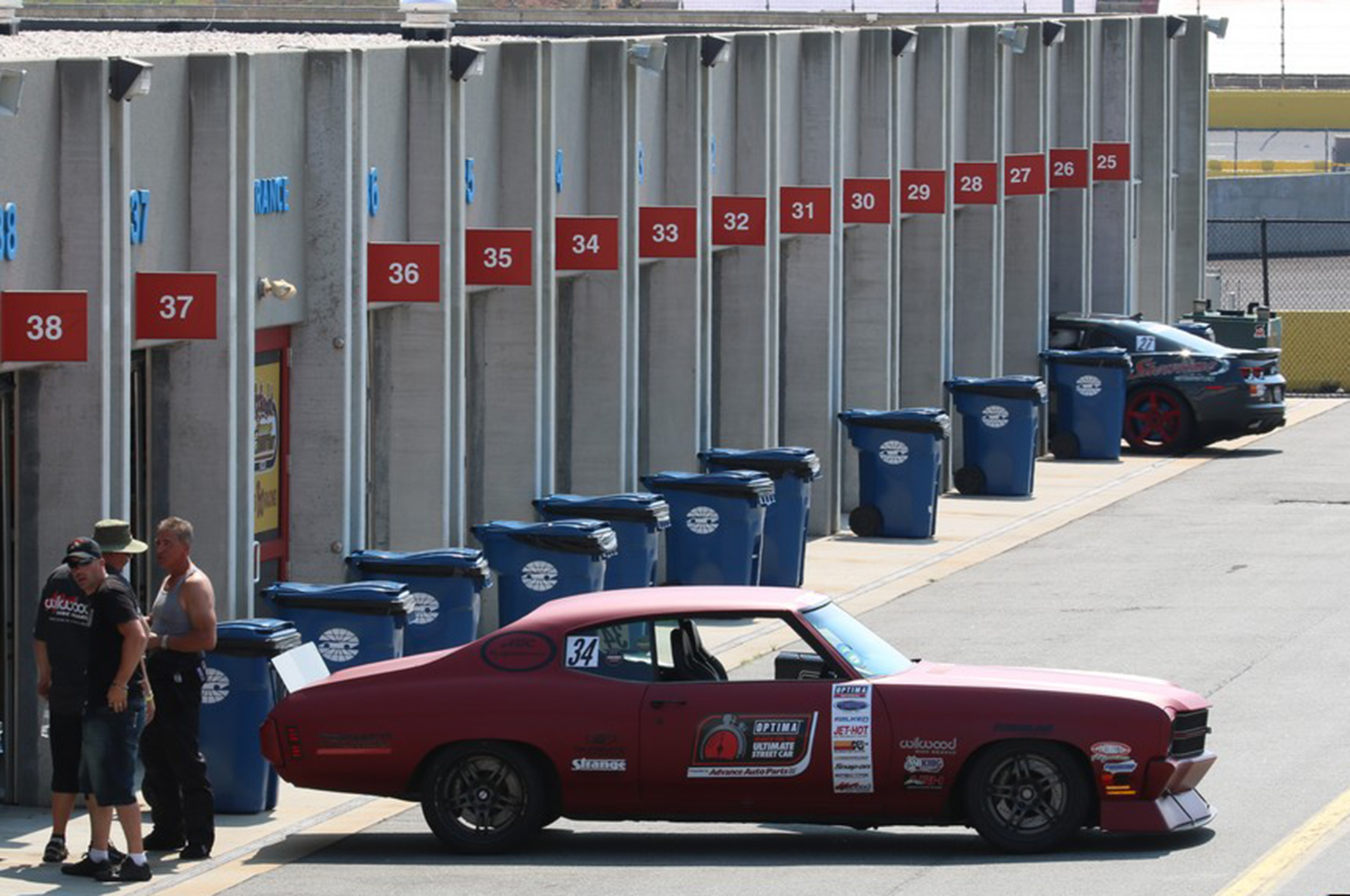 Tony Grzelakowski takes a break from running on the high banks of Charlotte Motor Speedway and lets his 1970 Chevelle cool off in the same NASCAR garages the pros use.