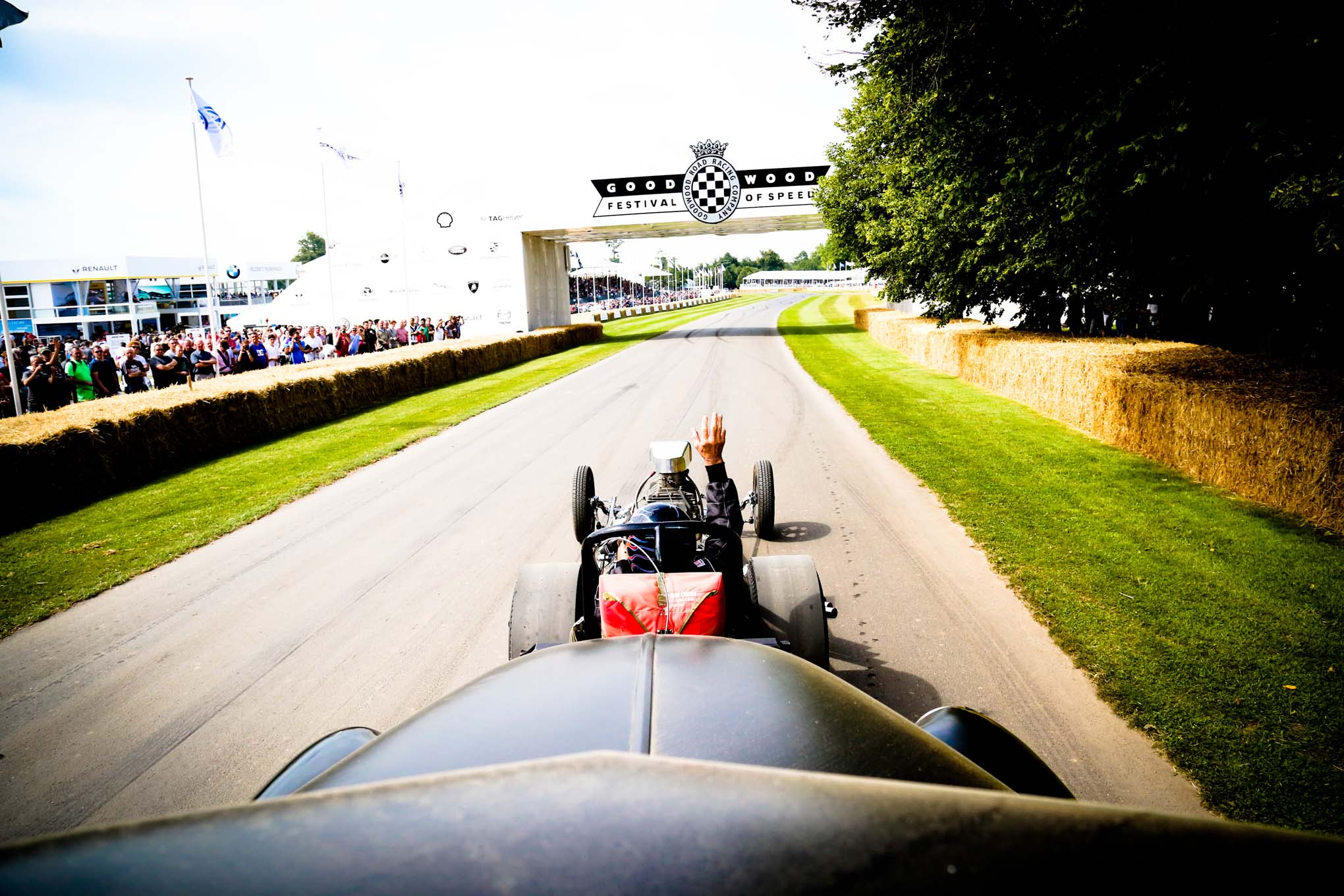 Participating cars do exhibition runs and timed runs up the 1.16-mile Goodwood estate driveway. After Garlits' first burnout kicked off a blower belt, his second dropped a valve.