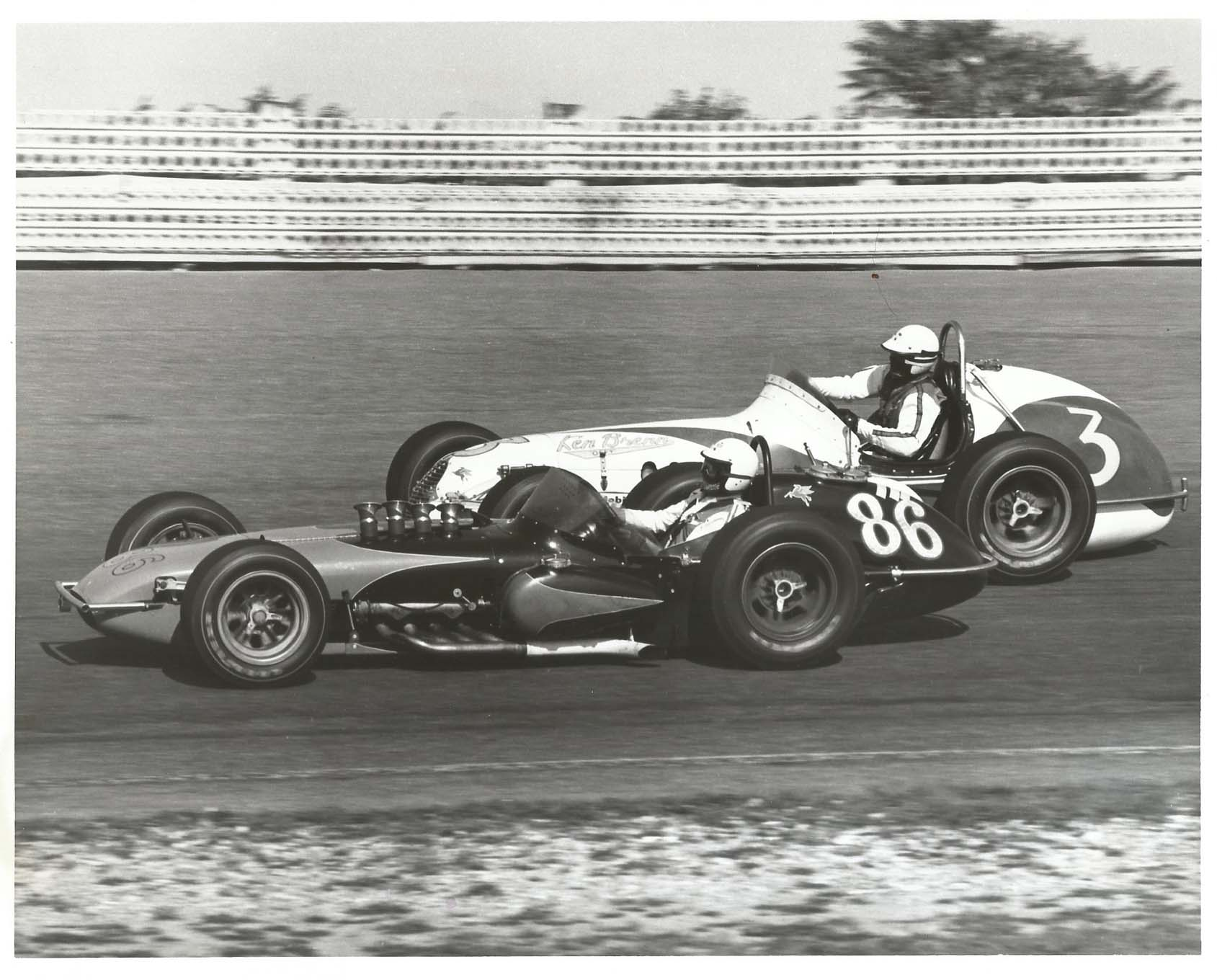 """That's Skip driving in the Trenton 200 in 1965, in as nasty-slippery a laydown roadster as you'll ever see. The Offy was almost on its side, in contrast with Wally Dallenbach next to Skip. """"I acquired it in 1962 and drove it in 1963 through '65,"""" says Skip. He finished 21st that race. Not impressed? While A.J. Foyt won the 200, Skip finished ahead of the likes of Rodger Ward, Jim Hurtubise, and Lloyd Ruby. He funded himself."""