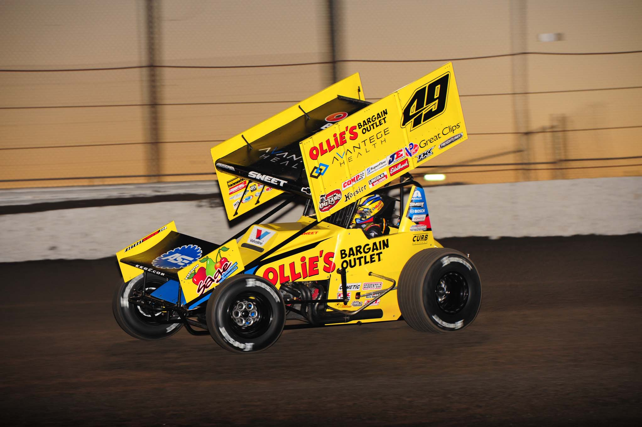Brad Sweet wheels his Outlaw as the sun sets in the background.