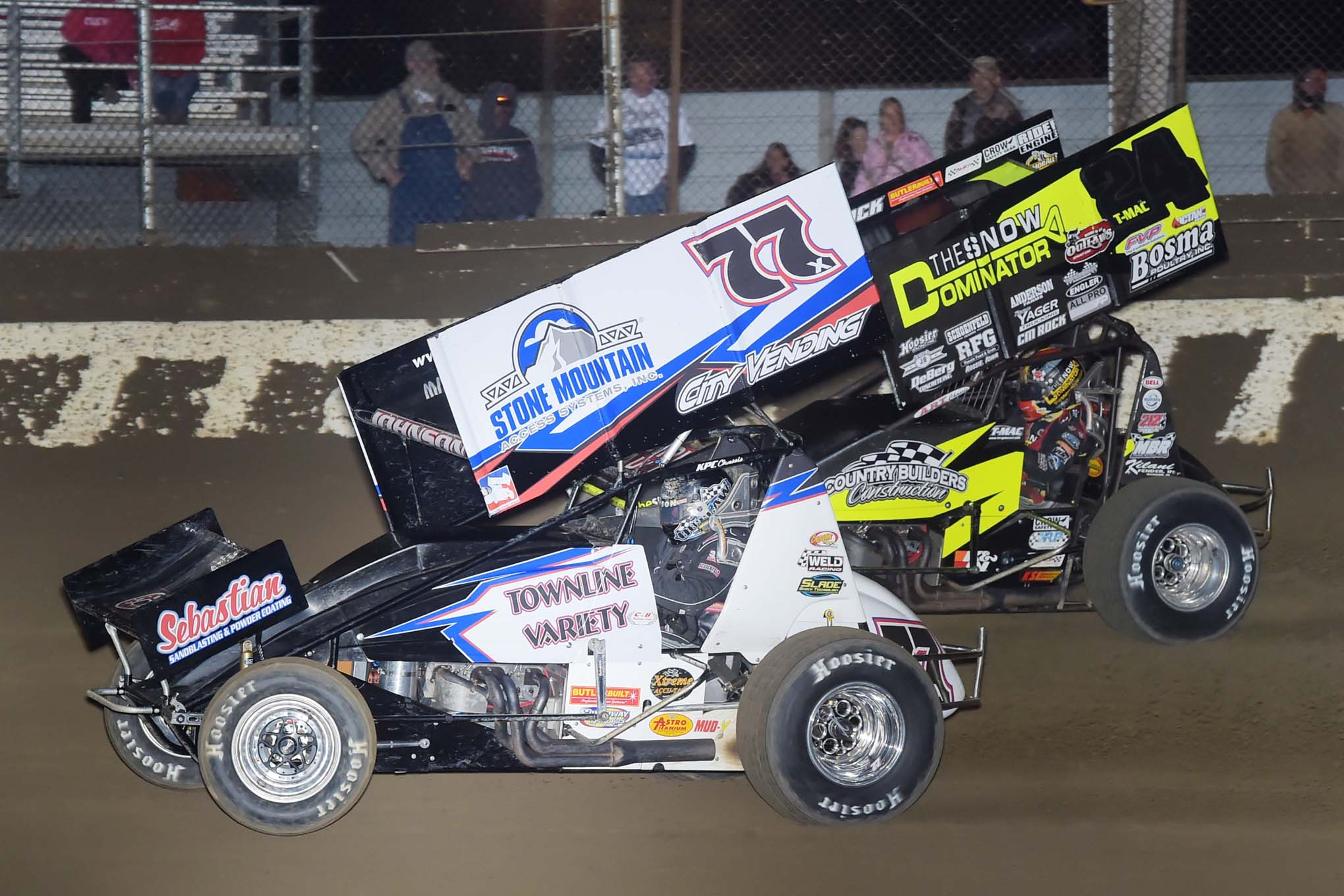 Wayne Johnson (77x) tries to fend off Terry McCarl (24). T-Mac has one NSL win and is Top 5 in point standings.