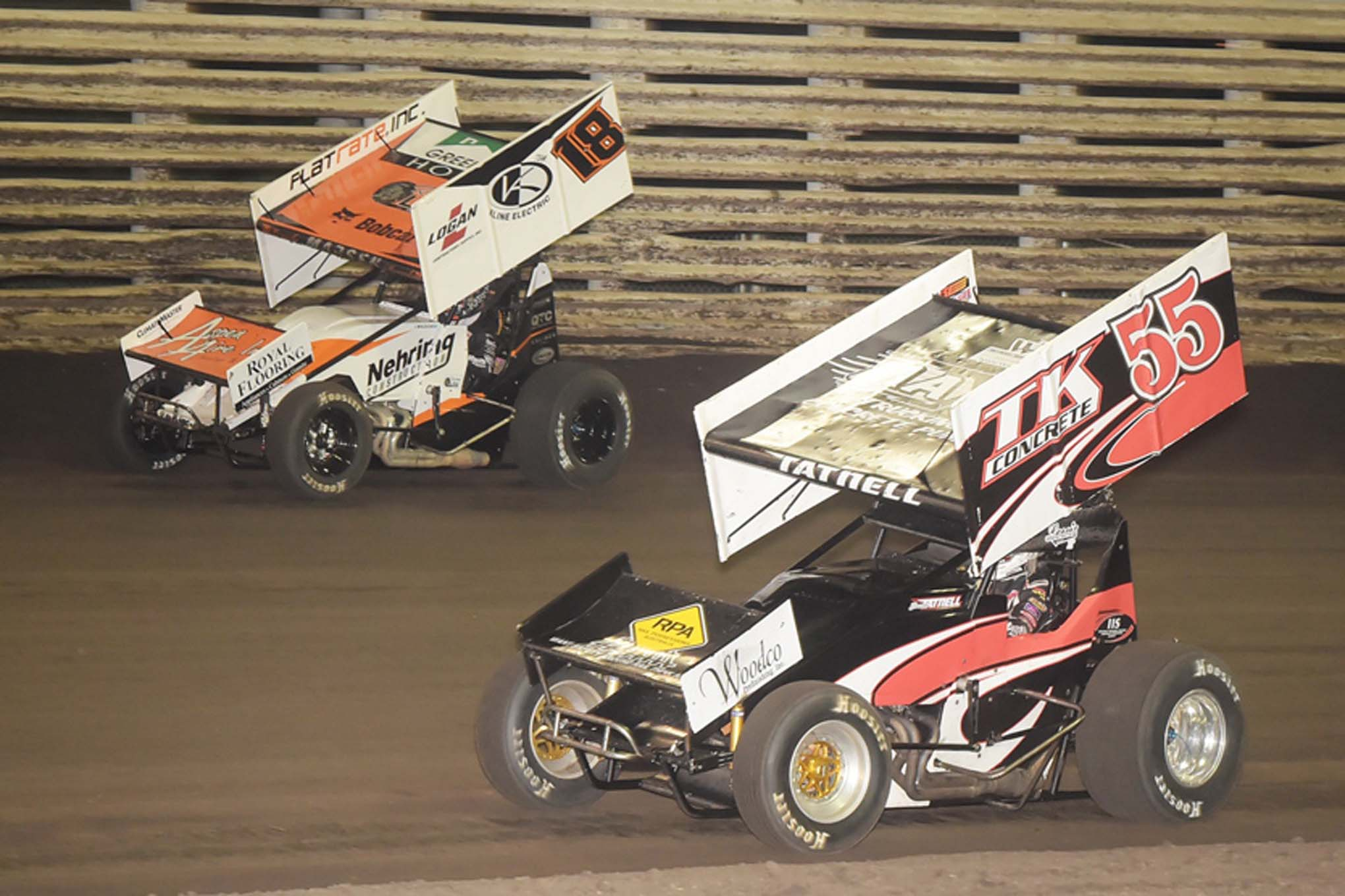 Brook Tatnell (55) and Ian Madsen (18) joust for position at Knoxville. Close ties to Knoxville Raceway has helped the NSL get off the ground.