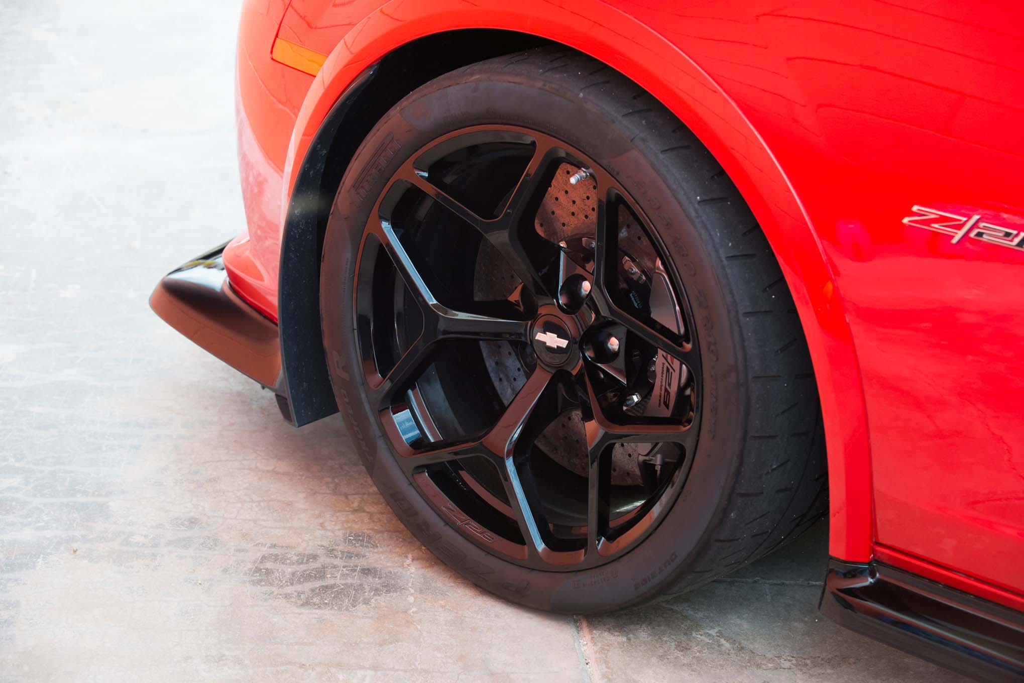 While the handling of any car is a system, depending on multiple components, there's no replacement for really good rubber. The Z/28 rolls on 19x11 front, 19x11.5 rear wheels and wraps them in Pirelli PZero Trofeo 305/30R19 tires; $2,200 can get you a set of the Pirellis for your own car, assuming you have enough fender clearance to wear them.