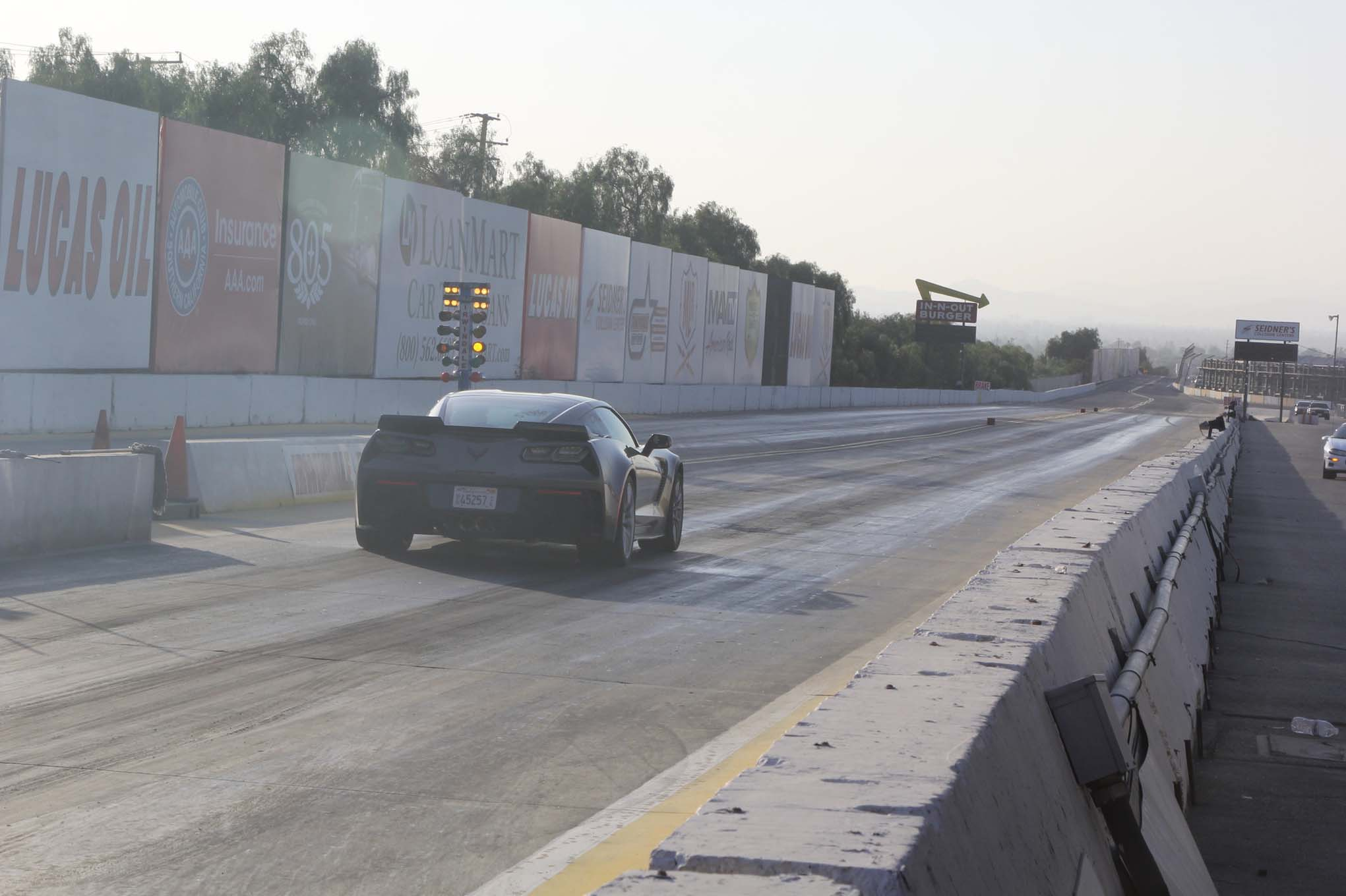 "We had high hopes for the Z06 on the dragstrip, as Chevrolet advertises it as capable of low 11-second quarter-miles. We only had access to our local Thursday grudge night at the Irwindale Speedway eighth-mile track, but we expected to see low- to mid-7s. After the first burnout, the car started pulling power, giving us a dead spot just after launch and resulting in a disappointing 8.59 at 93 mph. A second pass had the same result and lit the check-engine light. A scanner showed us code P0503, ""Vehicle Speed Sensor A Intermittent, Erratic, or High."" Convinced that it wasn't in danger of blowing up, but also that it wasn't going to run the number that night, we limped it home. Note that reduced power in a Z06 Corvette is still plenty fast enough to get you in trouble. The light was off the next day and everything was back to normal. We checked in with Chevrolet and Corvette Chief Engineer Tadge Juechter explained that we had probably triggered the code during the burnout. ""It typically occurs when the driver breaks traction in Second or Third gear, and then quickly pushes in the clutch."" The ECM reads that rapid change in tire speed as a sensor fail and goes into a safety mode. After a few on/off cycles, the car realizes it made a mistake and goes back to normal. This is what happened to us, although it took more than a few cycles before the light turned off and we got full power back. Juechter says there is an updated calibration that should prevent the issue for customers. If we had driven the car around a bit and turned it on and off a few more times, we might have been able to keep racing that night. Oh well, our mistake is your knowledge gain."